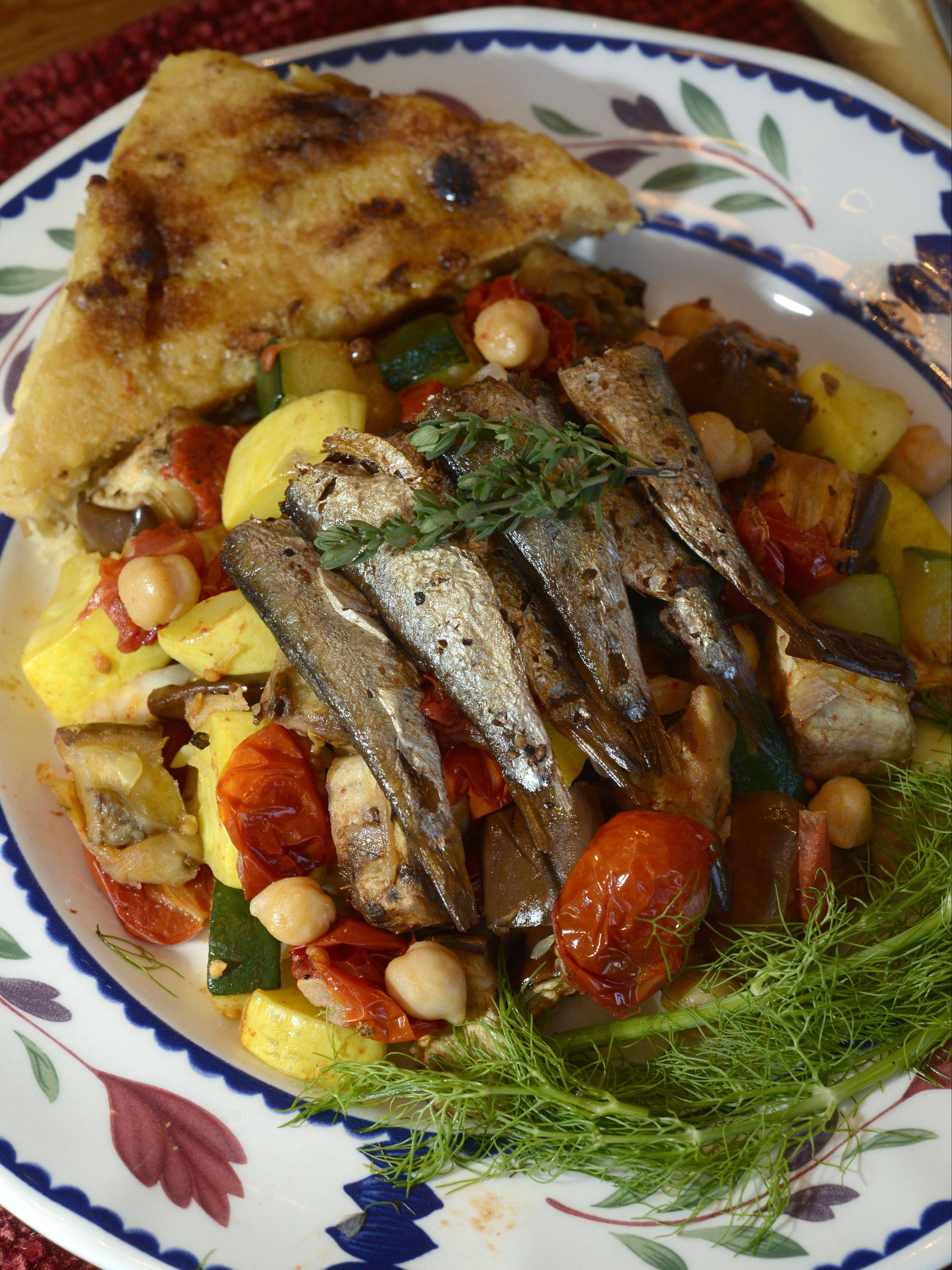Mike Baron of South Elgin worked with sardines, chick peas, fennel and golden raisins to creat a ratatouille, fried sardines, grilled polenta with walnuts, cheese and golden raisins.