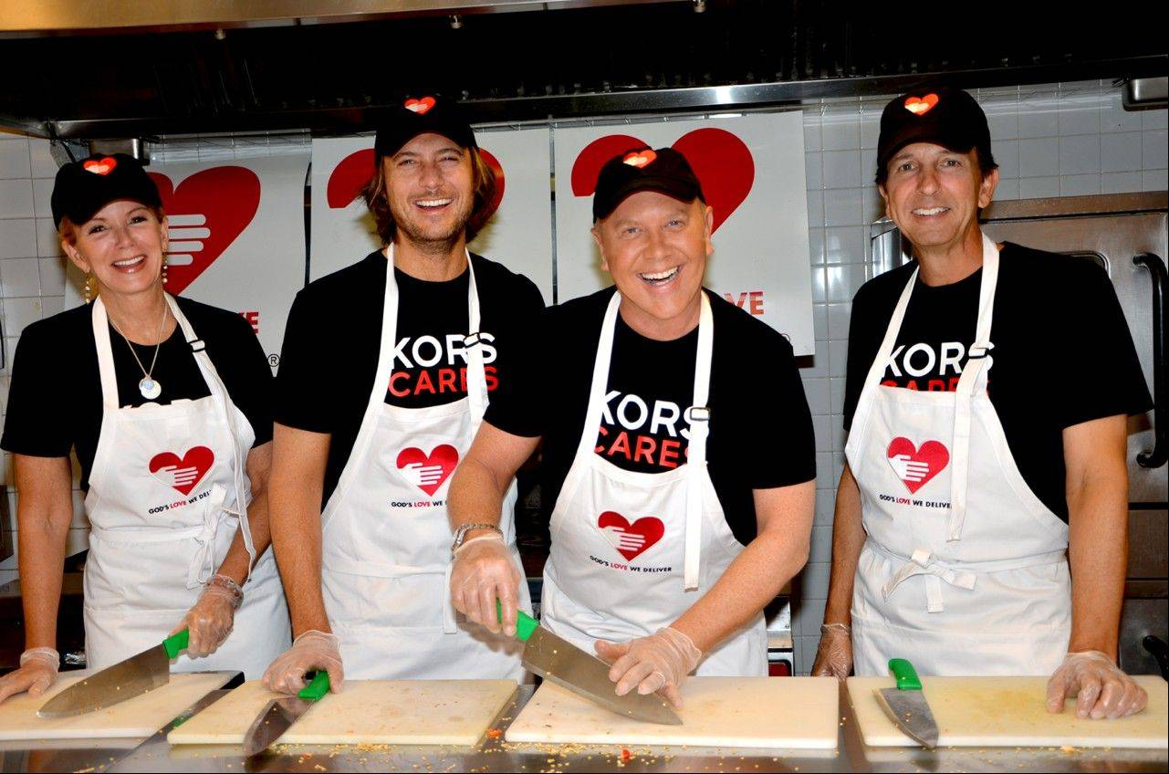 Blaine Trump, left, Lance Le Pere, Michael Kors and John Idol at Kors' annual volunteering for God's Love We Deliver in New York. On Wednesday, Michael Kors embarks on a new campaign: World Hunger Day.