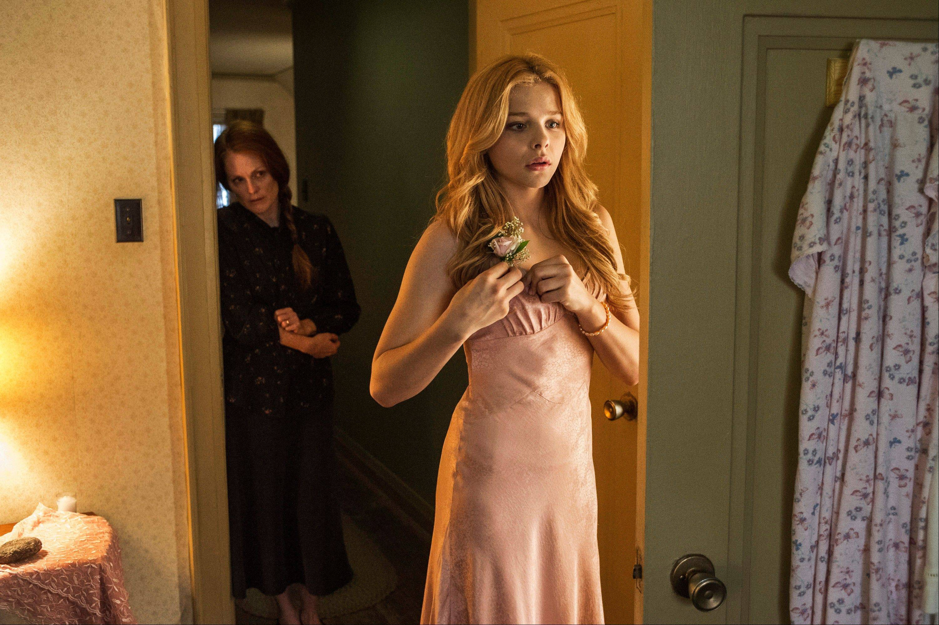 Margaret White (Julianne Moore), left, isn�t so sure about her daughter Carrie (Chloe Grace Moretz) going to prom in the latest update of �Carrie.�