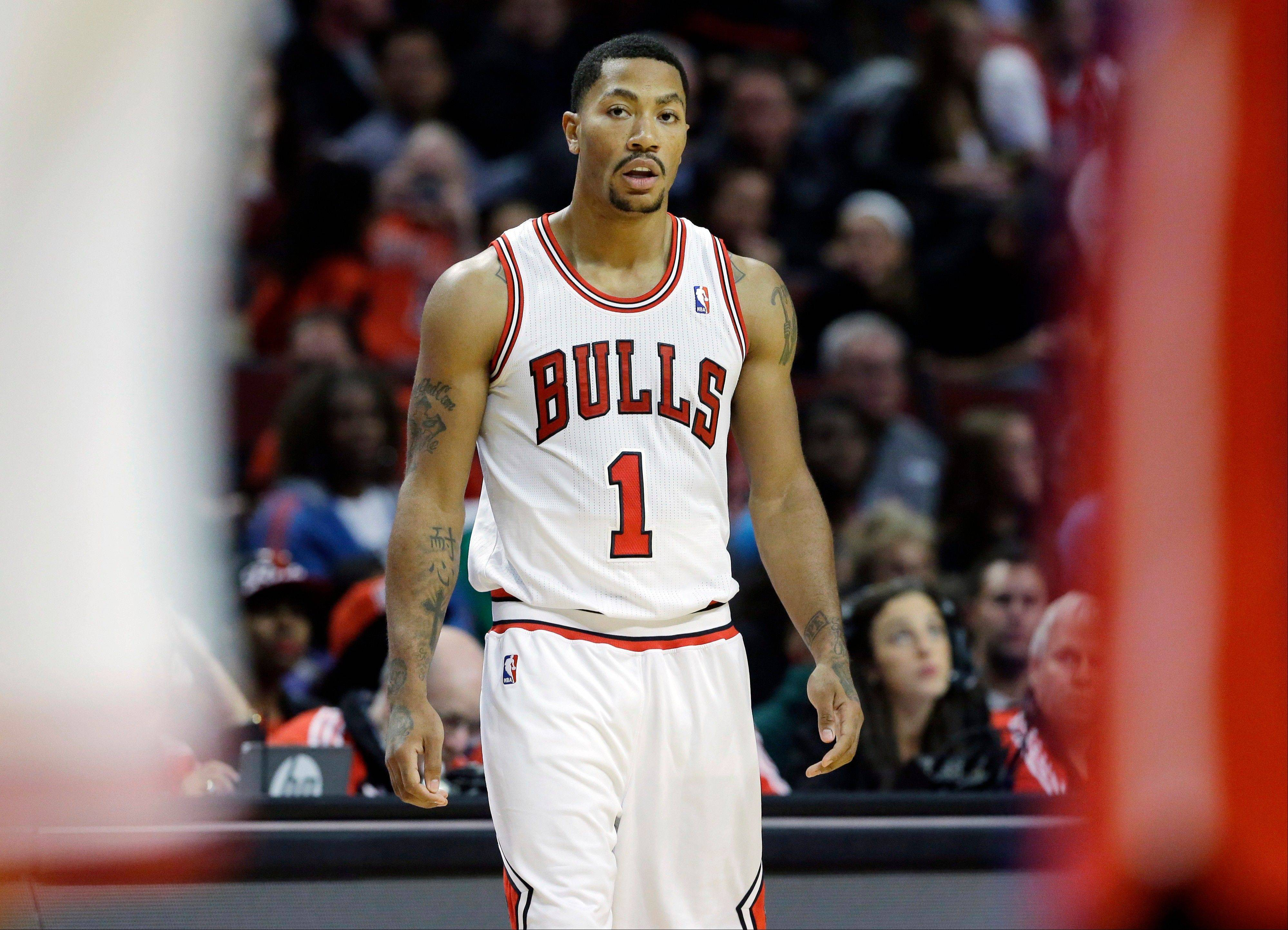 Bulls guard Derrick Rose looks to his teammates during the first half of Wednesday night�s preseason game against the Detroit Pistons. It was Rose�s first game on the UC floor since injury his knee 18 months ago.