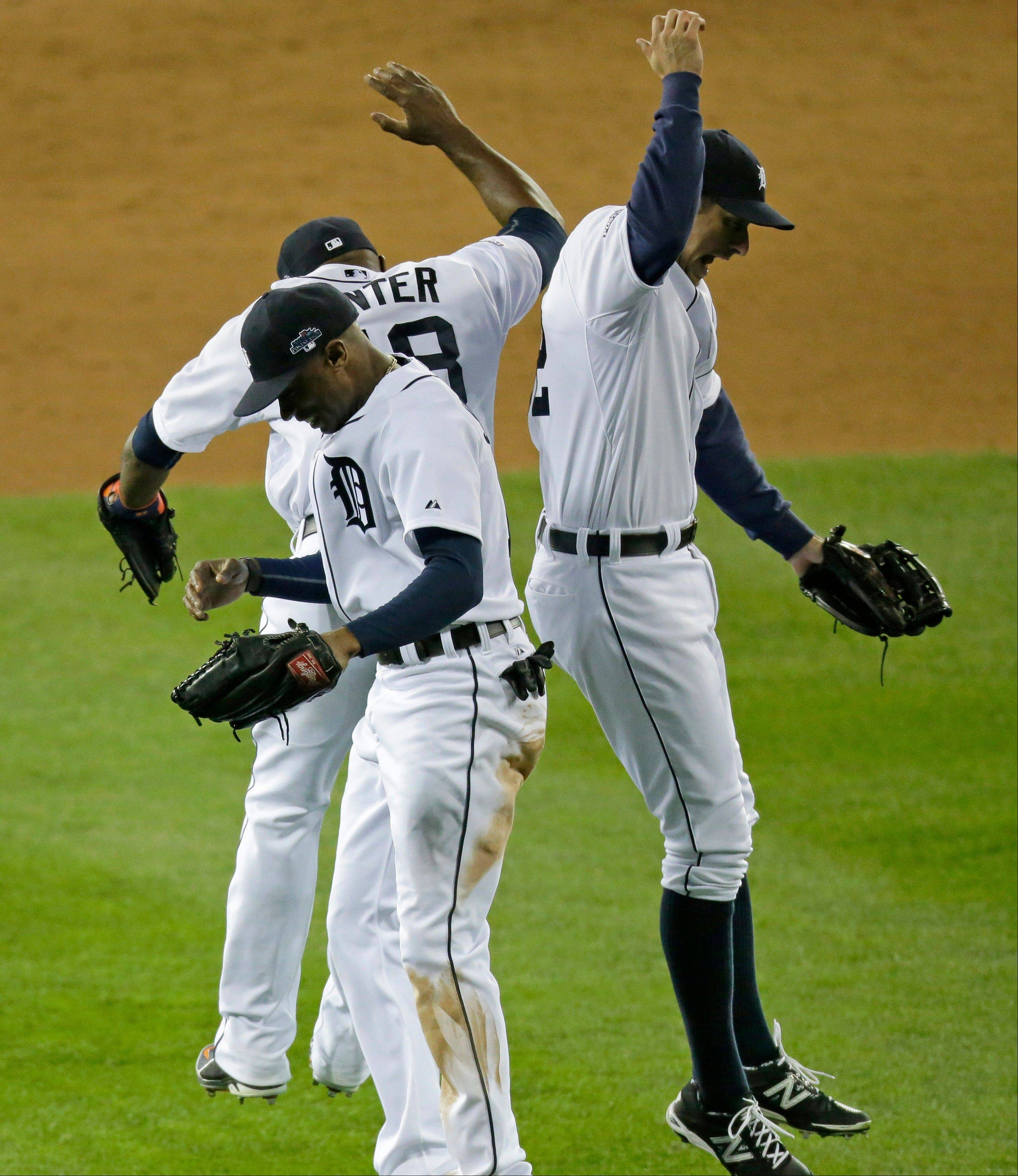 Detroit�s Austin Jackson, Torii Hunter, and Don Kelly celebrate Wednesday night after Game 4 of the American League Championship Series against Boston. The Tigers won 7-3 at home.