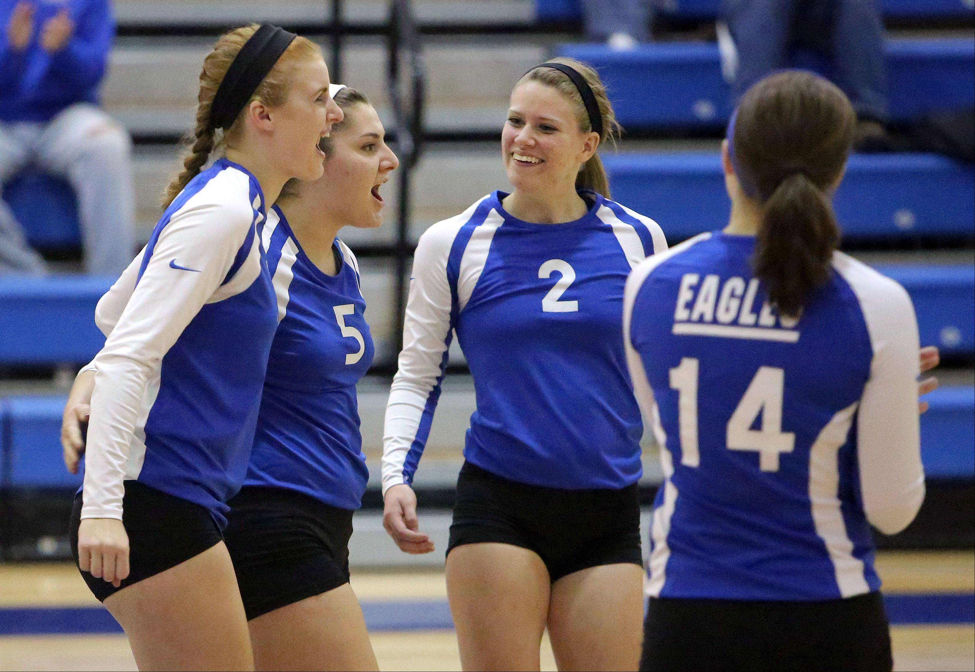 Lakes' Lisa Buehler (2) and her teammates celebrate after winning the first game against Wauconda on Wednesday night at Lakes.