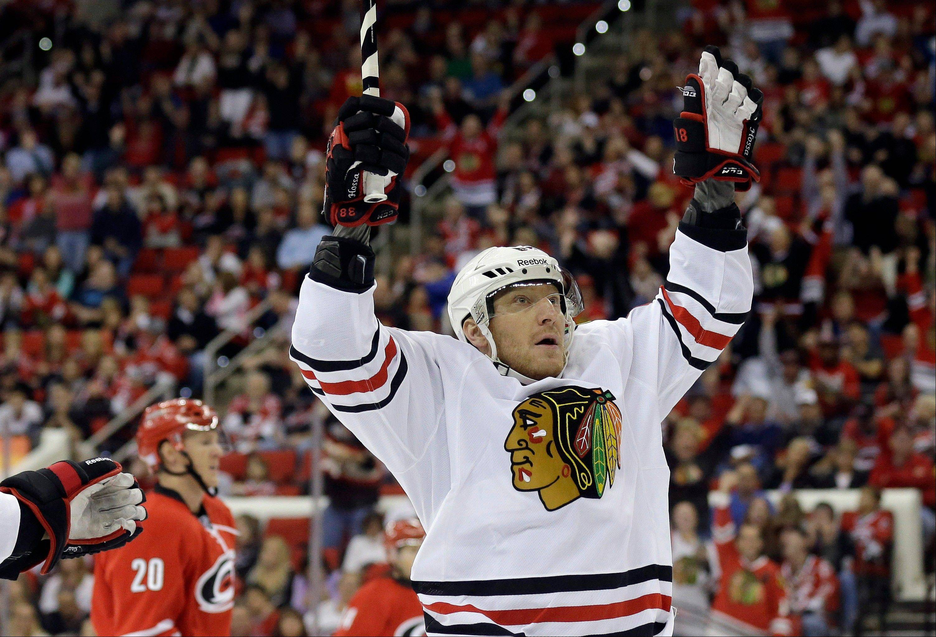 Marian Hossa celebrates after his goal in Tuesday�s victory over the Carolina Hurricanes.