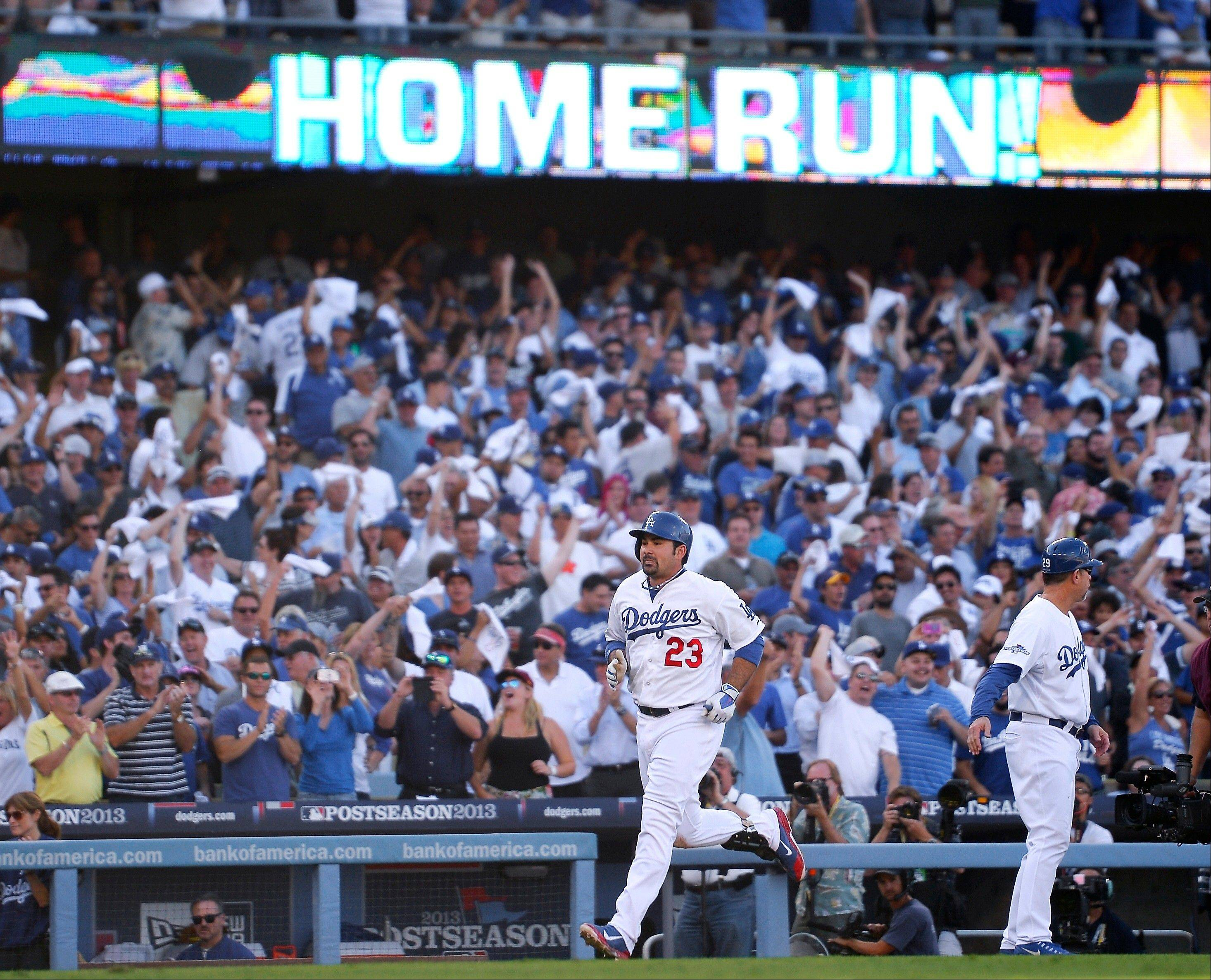 The Dodgers� Adrian Gonzalez rounds the bases after hitting a home run during the eighth inning of Game 5 of the National League Championship Series against the St. Louis Cardinals on Wednesday in Los Angeles. The Dodgers won 6-4.