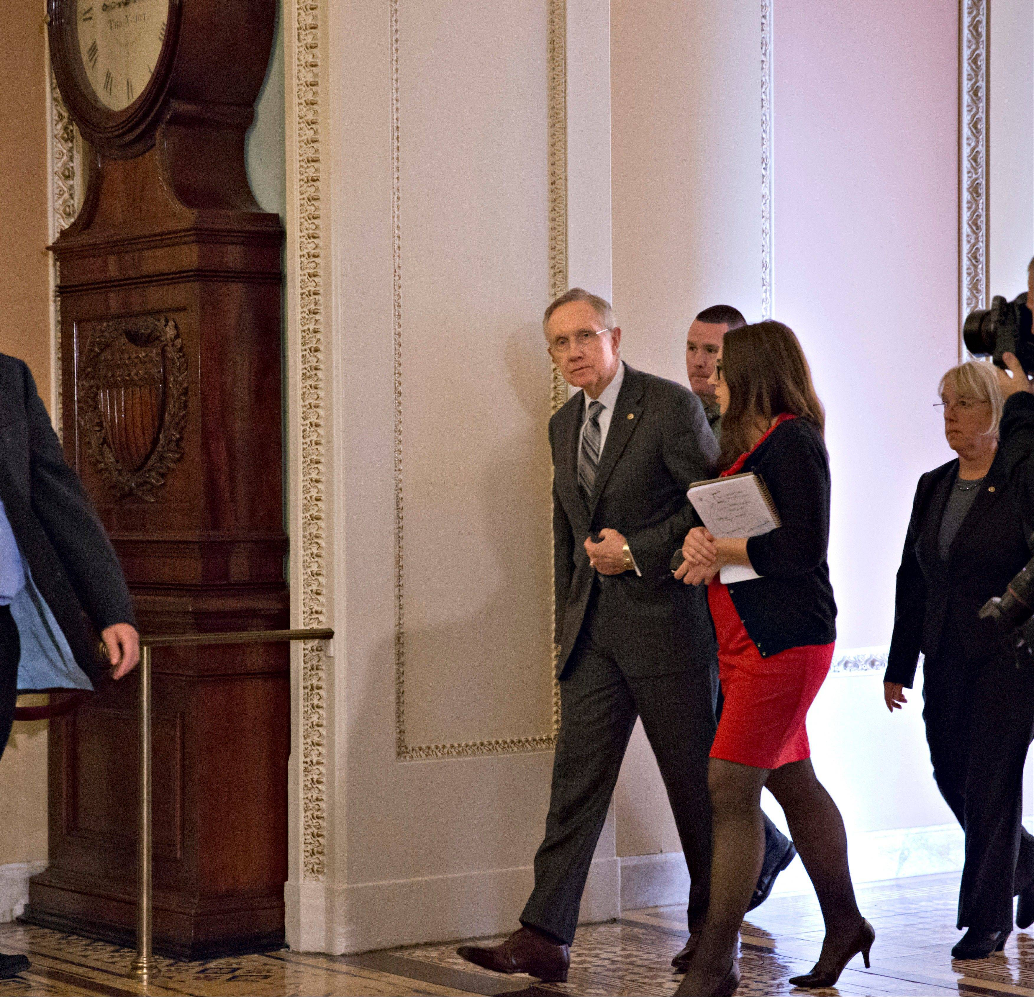 Senate Majority Leader Harry Reid, D-Nev., walks to the Senate floor following lunch with fellow Democrats, at the Capitol in Washington, Tuesday.