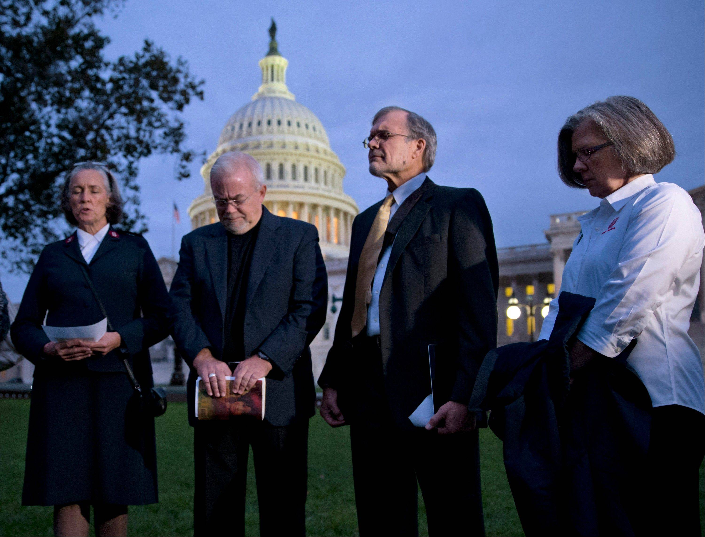 With time growing desperately short for Congress to prevent a threatened Treasury default and stop a partial government shutdown, a group of ministers, the Circle of Protection, pray at dawn at the Capitol to draw attention to lawmakers that political divisiveness hurts the most vulnerable Americans.