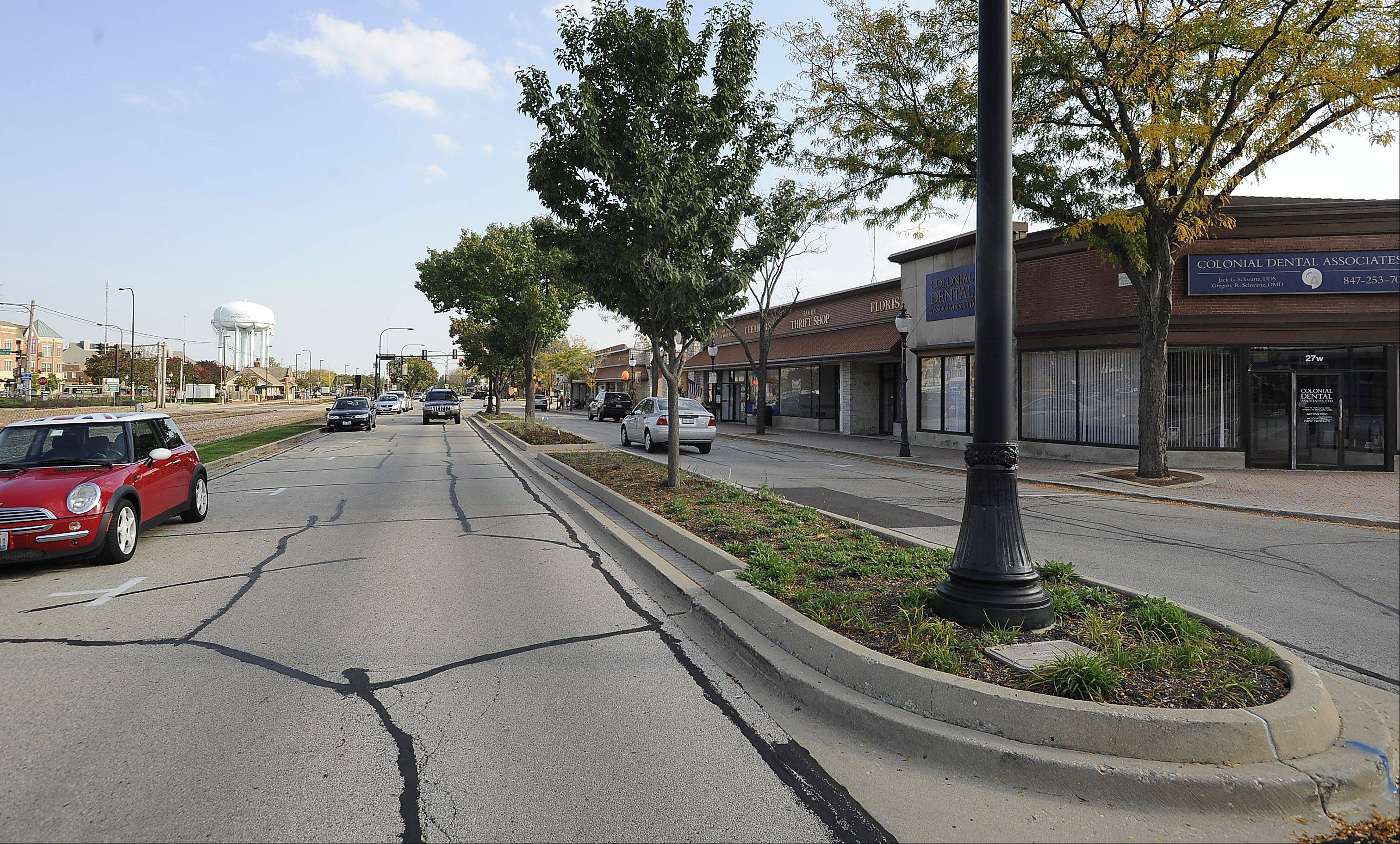 Prospect Avenue south of the tracks with its landscaped median and small shops in downtown Mount Prospect.
