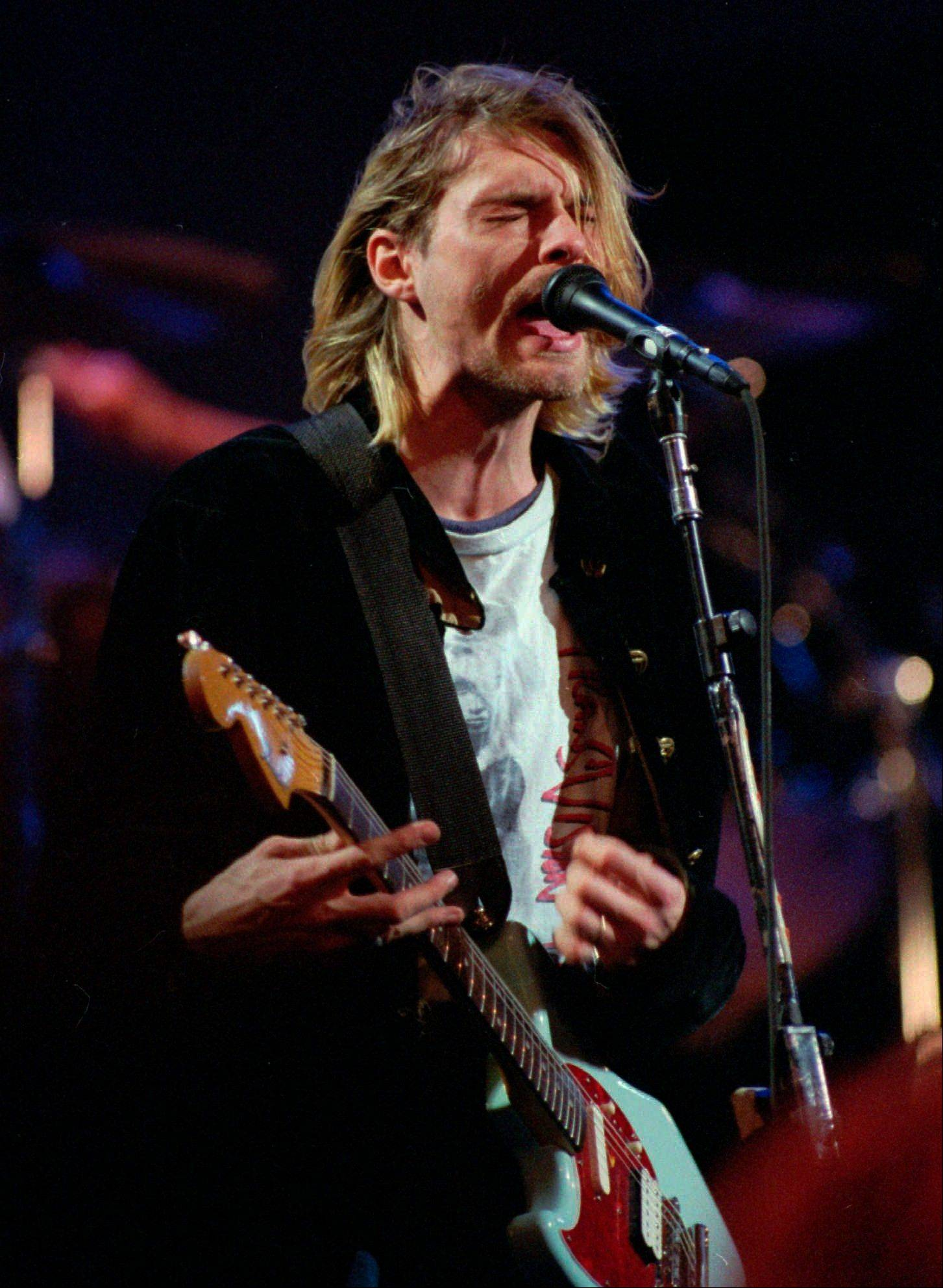 Kurt Cobain, lead singer for the Seattle-based band Nirvana, performing during the taping of MTV's Live and Loud Production in Seattle in 1993. Nirvana is among first-time nominees to the Rock and Roll Hall of Fame. The hall of fame announced its annual list of nominees Wednesday.
