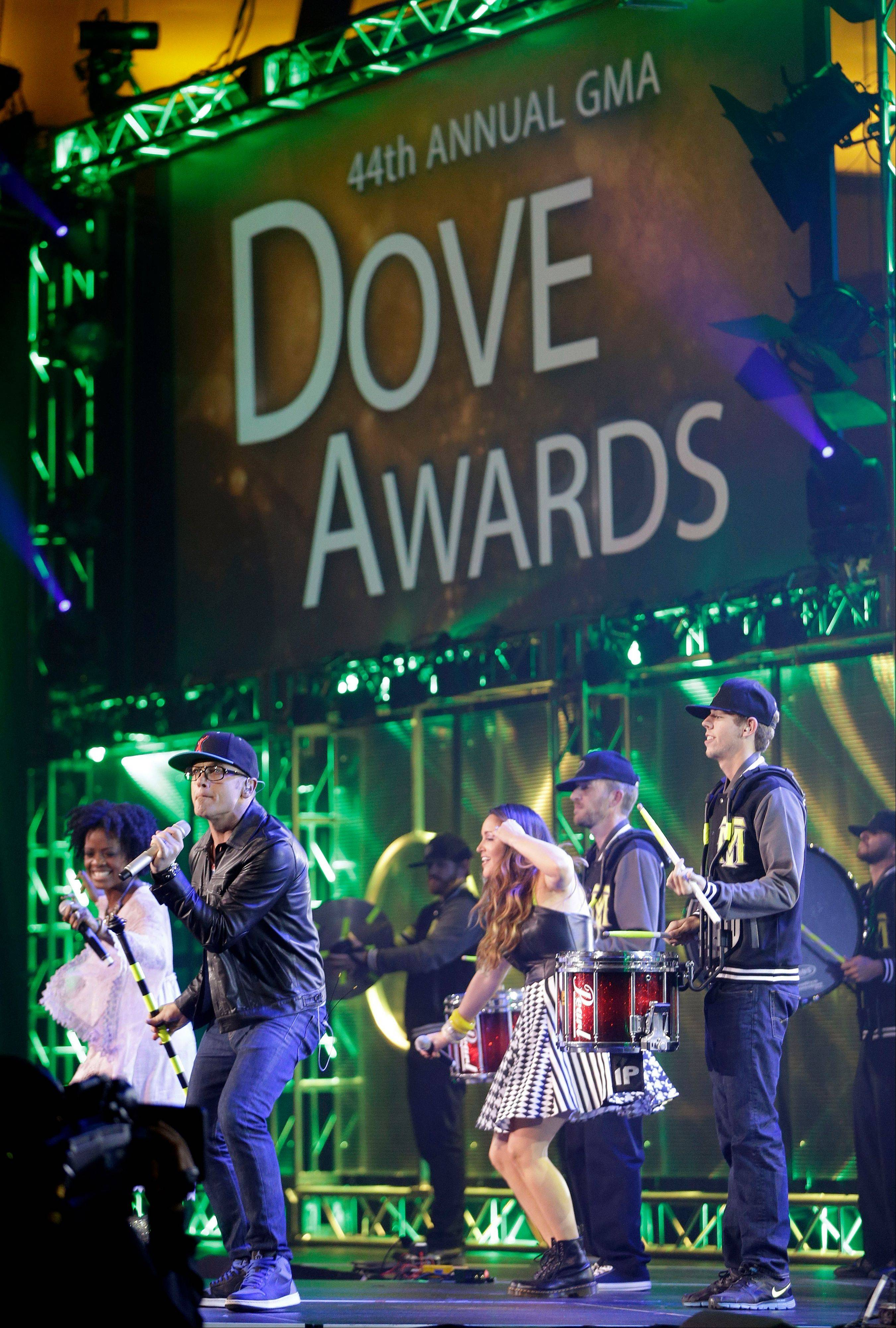 TobyMac, front left, performs at the Dove Awards on Tuesday in Nashville, Tenn. He was later named artist of the year.
