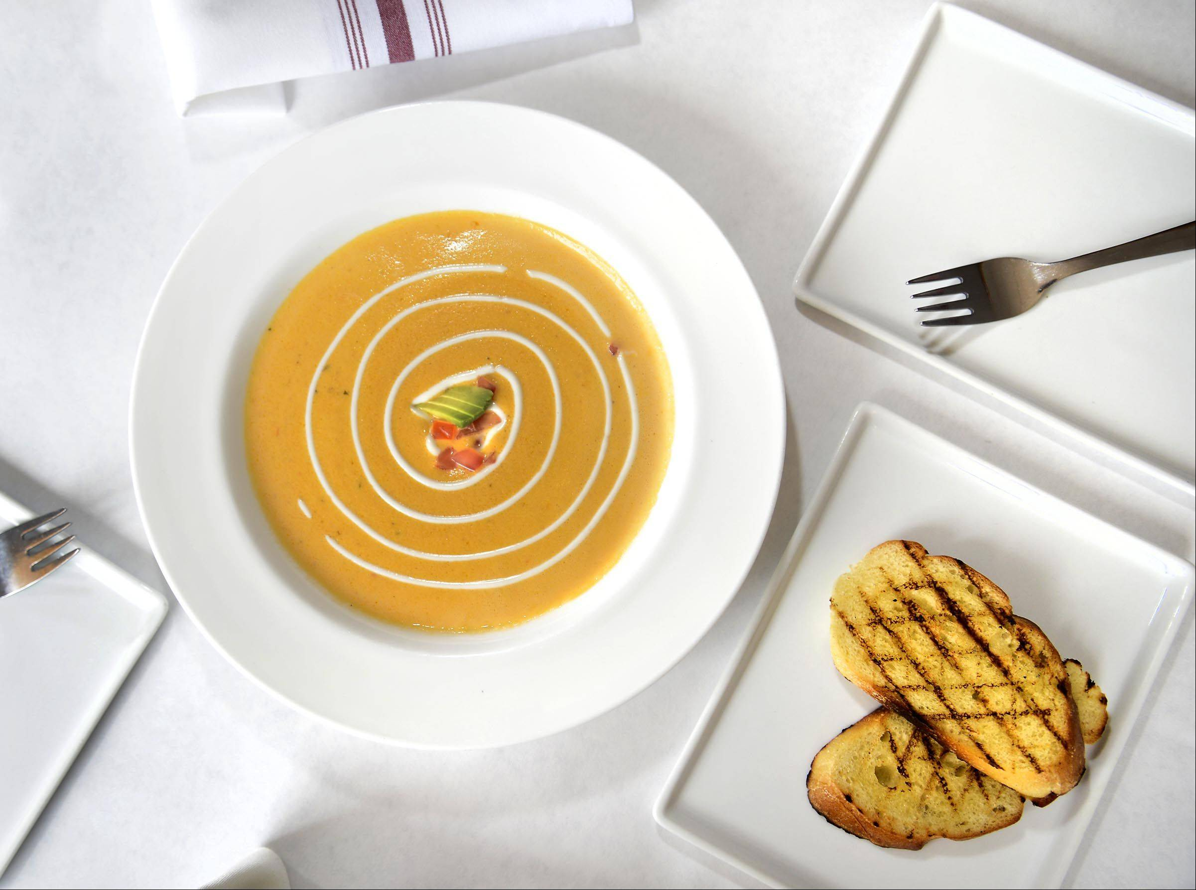 Roasting peppers tones down their heat and makes for a boldly flavored soup at Altiro in Geneva.