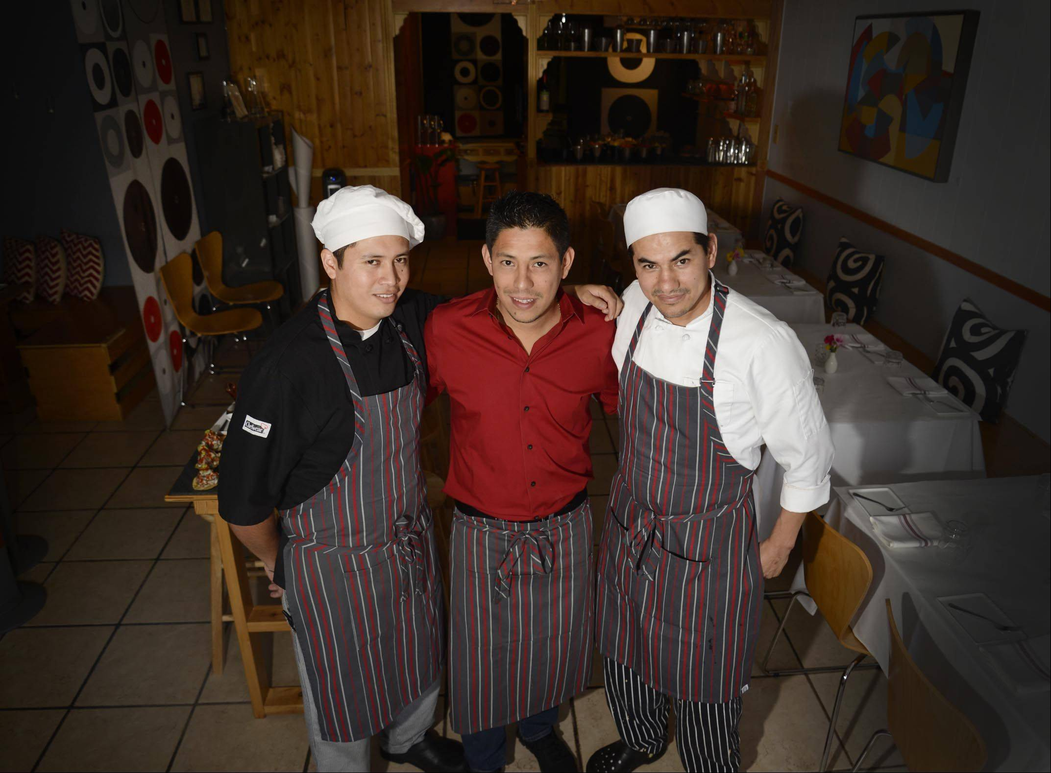 Chef Jose Trejo, left, and his brothers-in-law Miguel Villanueva and chef Roberto Avila run Altiro Latin Fusion in Geneva.