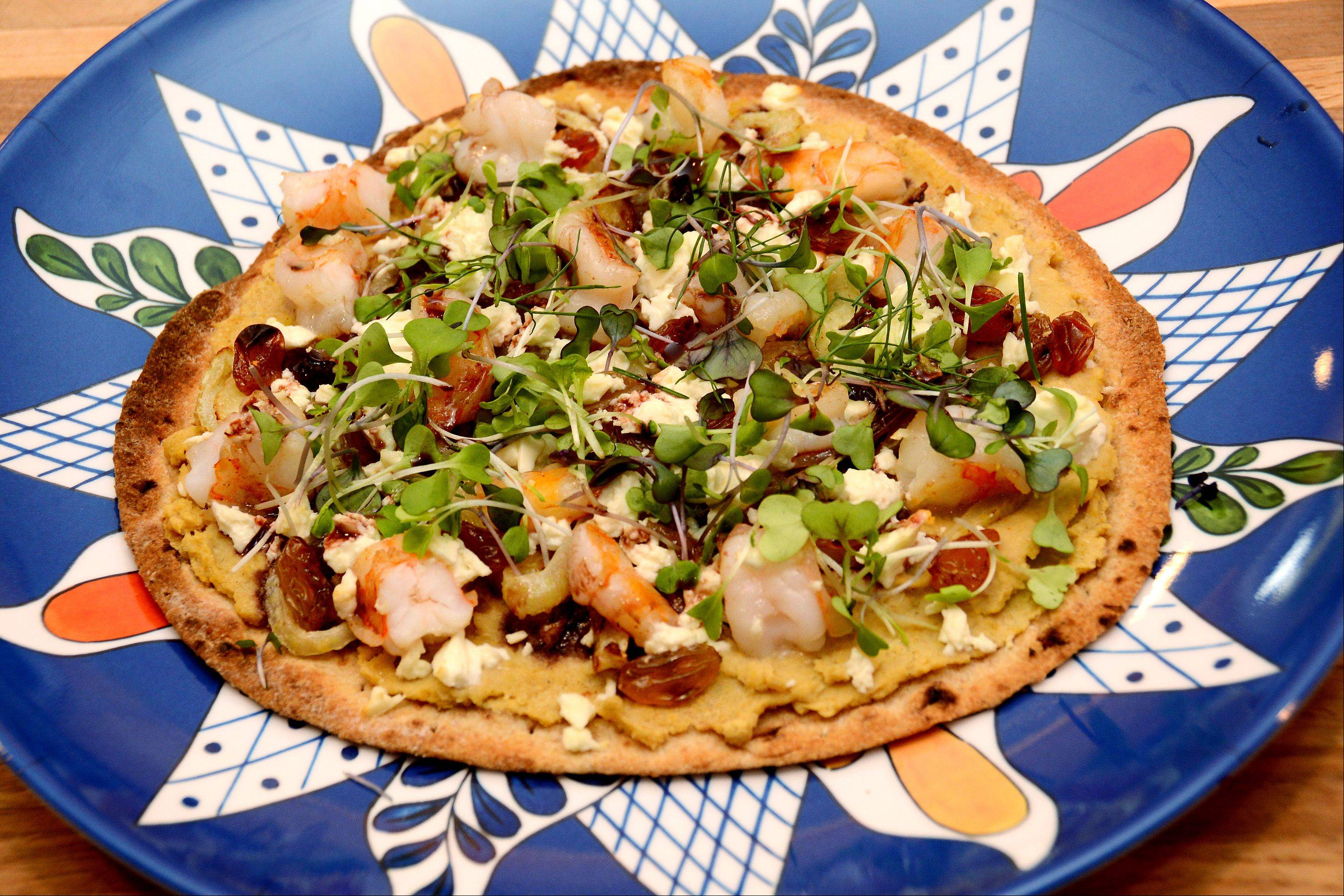 Lori Motyka created a hearty flatbread pizza with sardines, chickpeas (aka garbanzo beans), fennel and golden raisins.