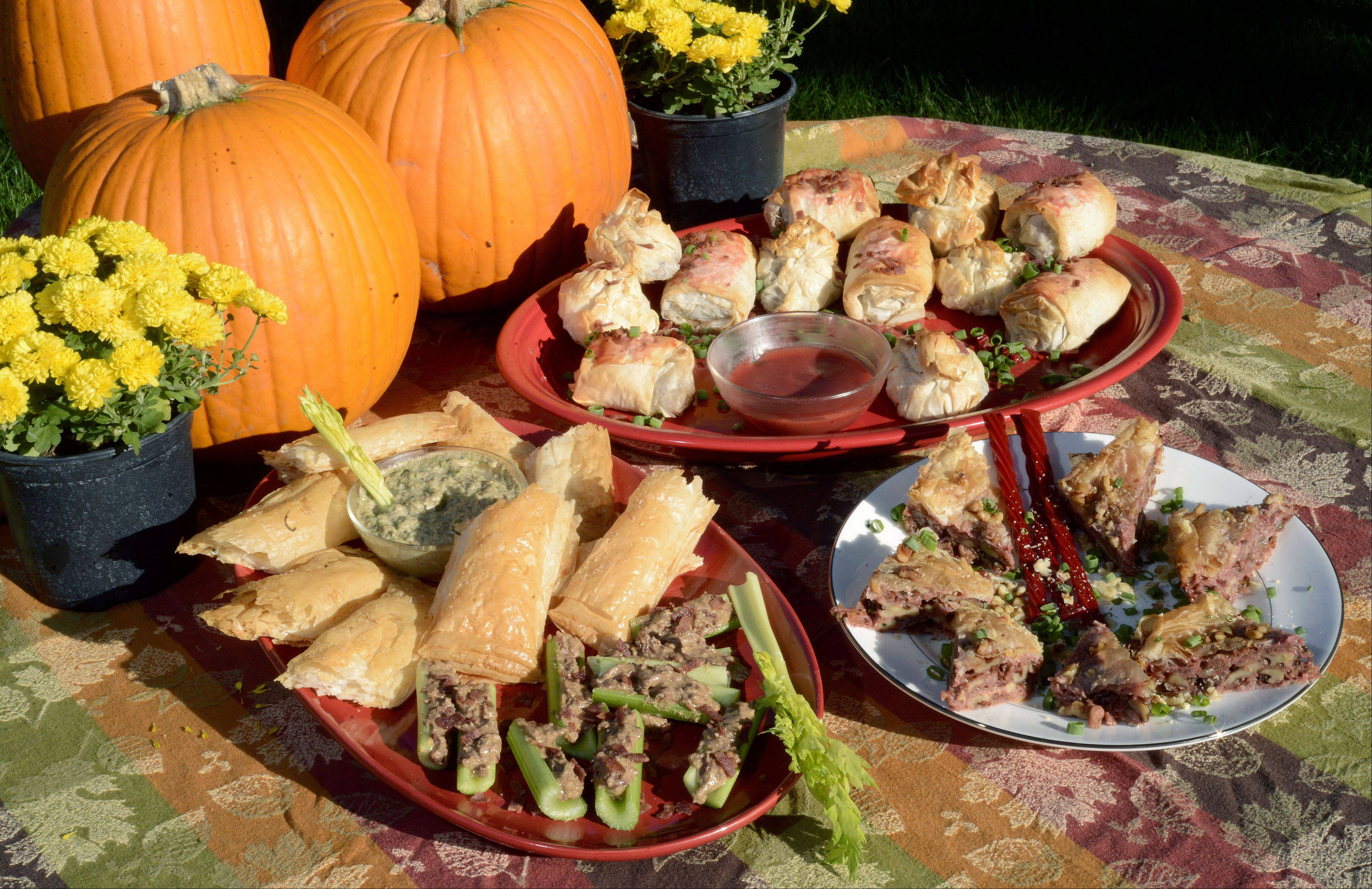 Dan Rich of Elgin created a party foods buffet featuring almond butter and bacon-stuffed celery boats, phyllo bombs, beef Wellington with almond butter pate, and savory baklava.