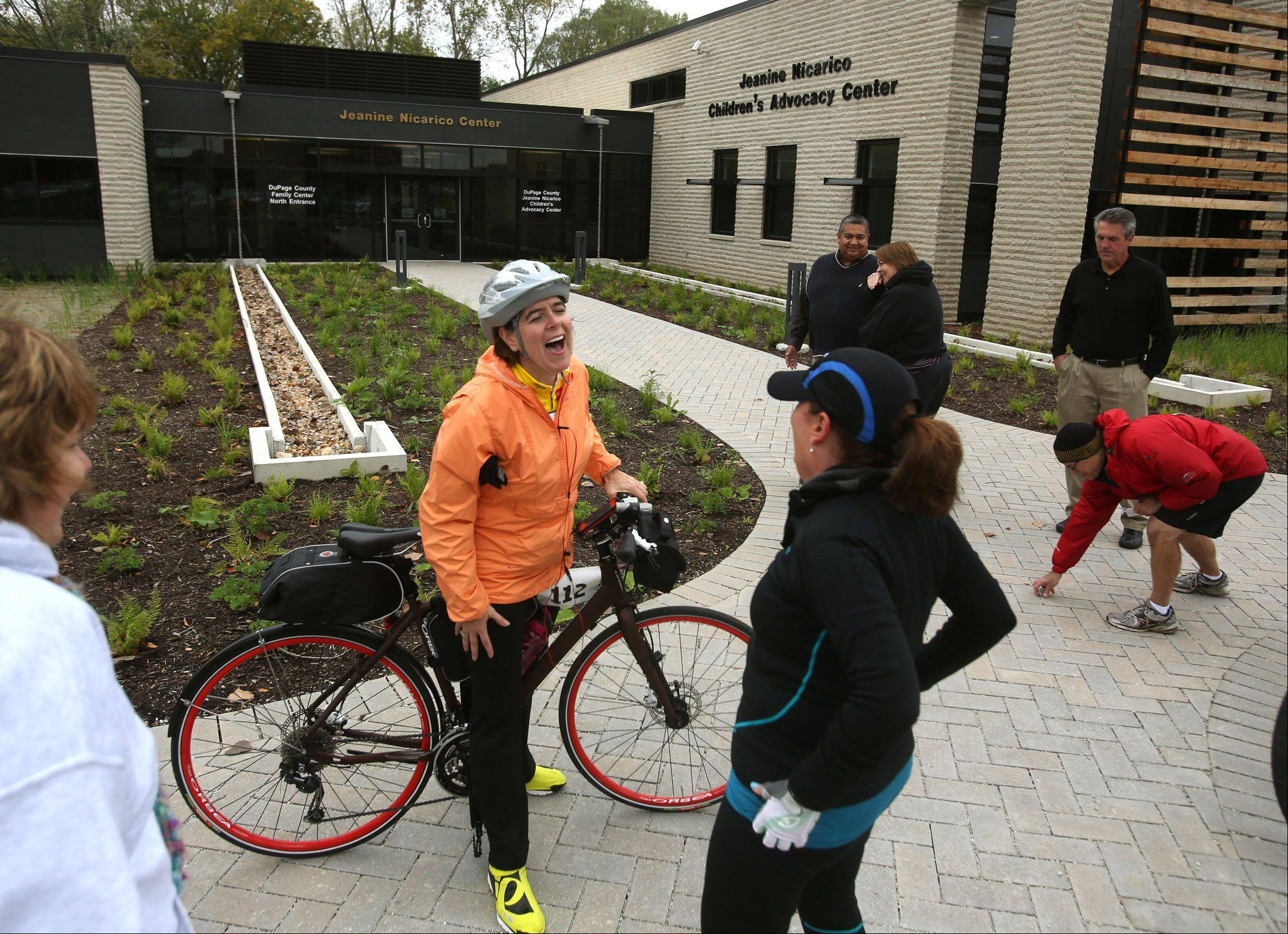 Alice Myk, left, of Downers Grove, talks with Lynette Garrett, of Antioch, during a break Wednesday in the inaugural Stop the Cycle of Abuse Ride in Wheaton.