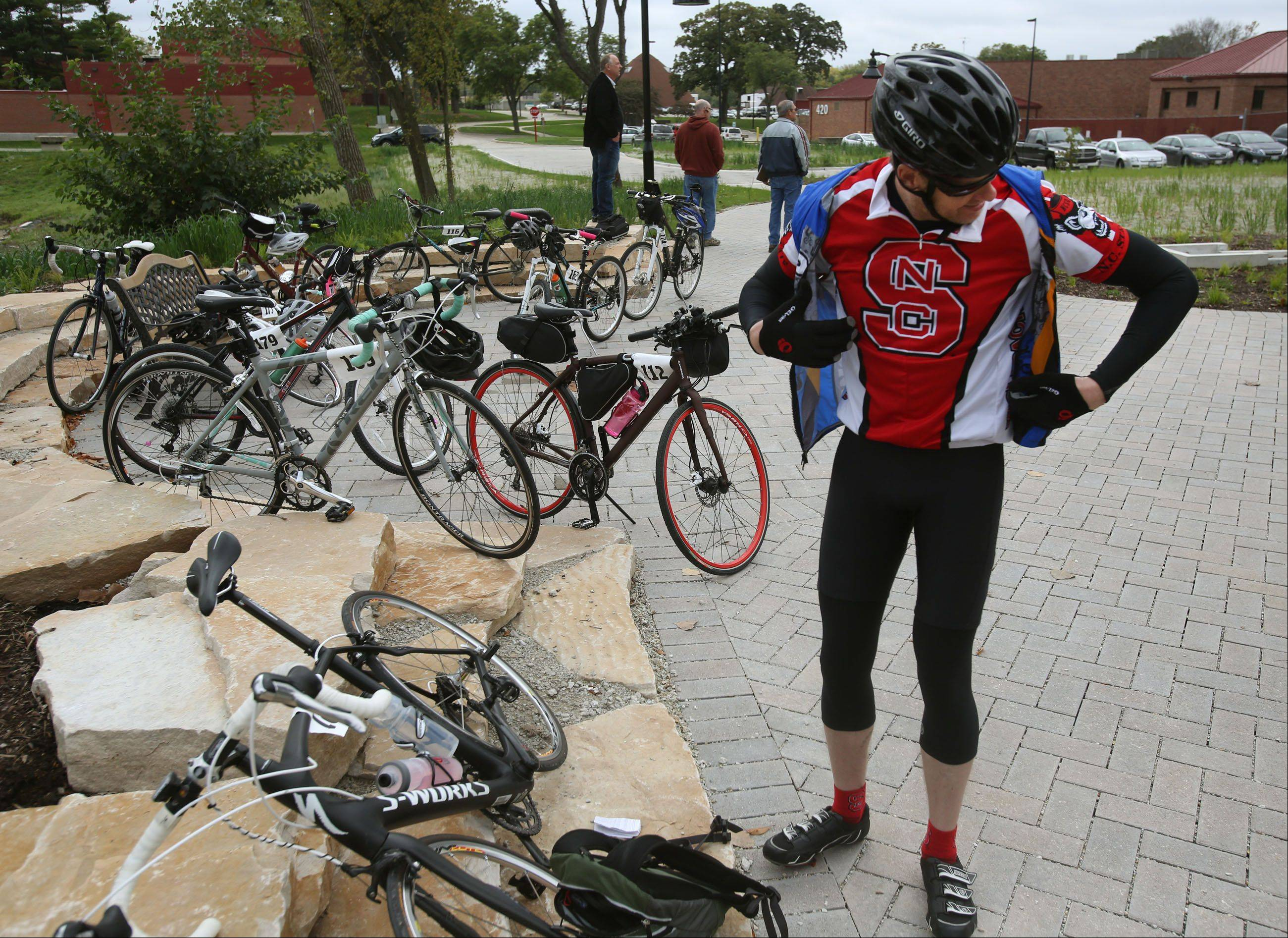 Justin Davis of Schaumburg takes a breather Wednesday during the inaugural Stop the Cycle of Abuse Ride in Wheaton. The 360-mile bike tour aims to raise $150,000 for services benefiting abused children.