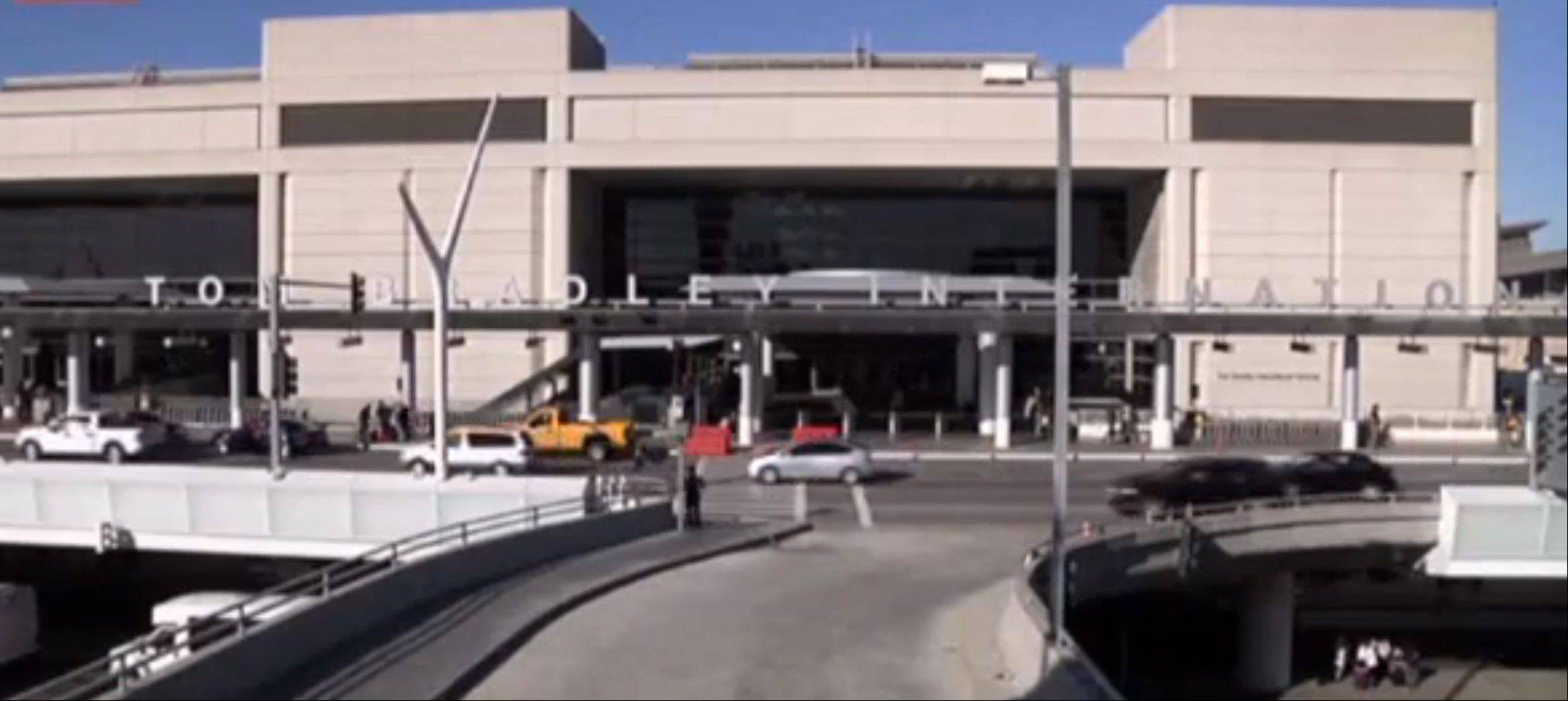 Associated PressA baggage handler was arrested Tuesday in connection with dry ice explosions Sunday and Monday at Los Angeles International Airport after police stepped up patrols and increased its checks on employees. DiCarlo Bennett, a 28-year-old employee for the ground handling company Servisair, was booked for possession of a destructive device near an aircraft.