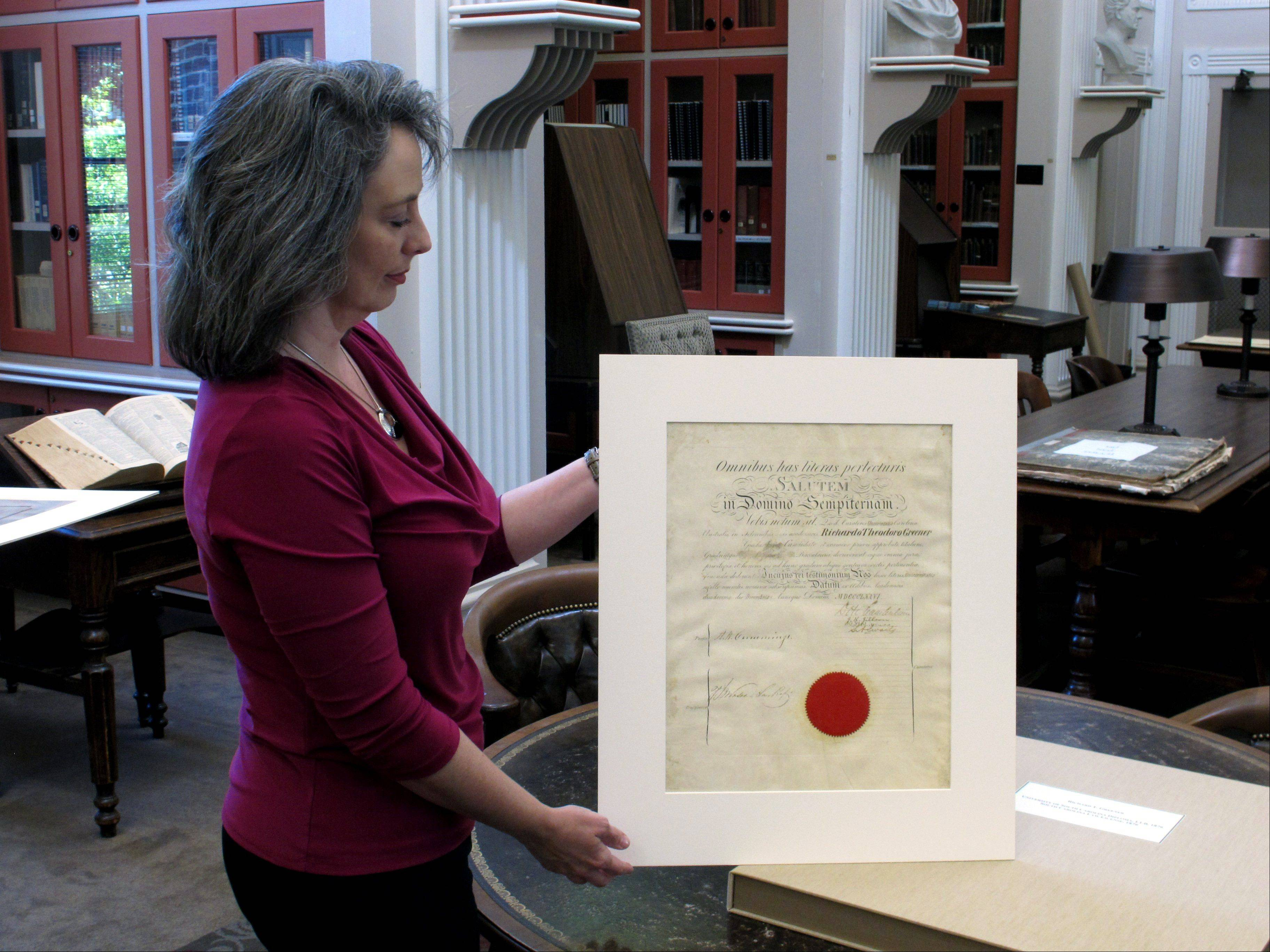 University of South Carolina archivist Elizabeth Cassidy West shows the diploma earned by Richard Theodore Greener.