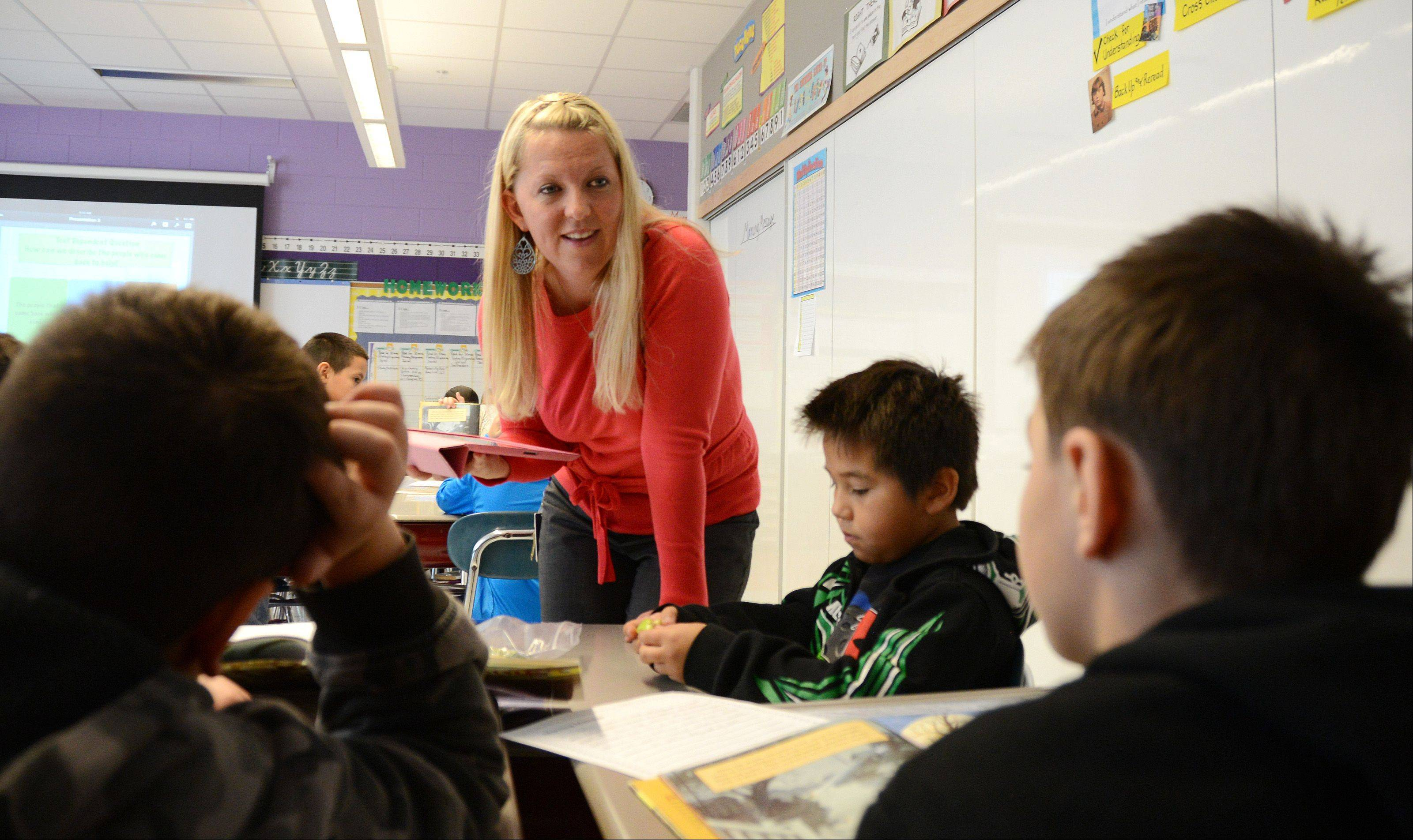 "Amy Walsh, a fourth-grade teacher at Tioga Elementary School in Bensenville, is one of 11 finalists for the state's Teacher of the Year Award. ""I love that moment when kids understand something, when you see that light in their eyes,"" she says."