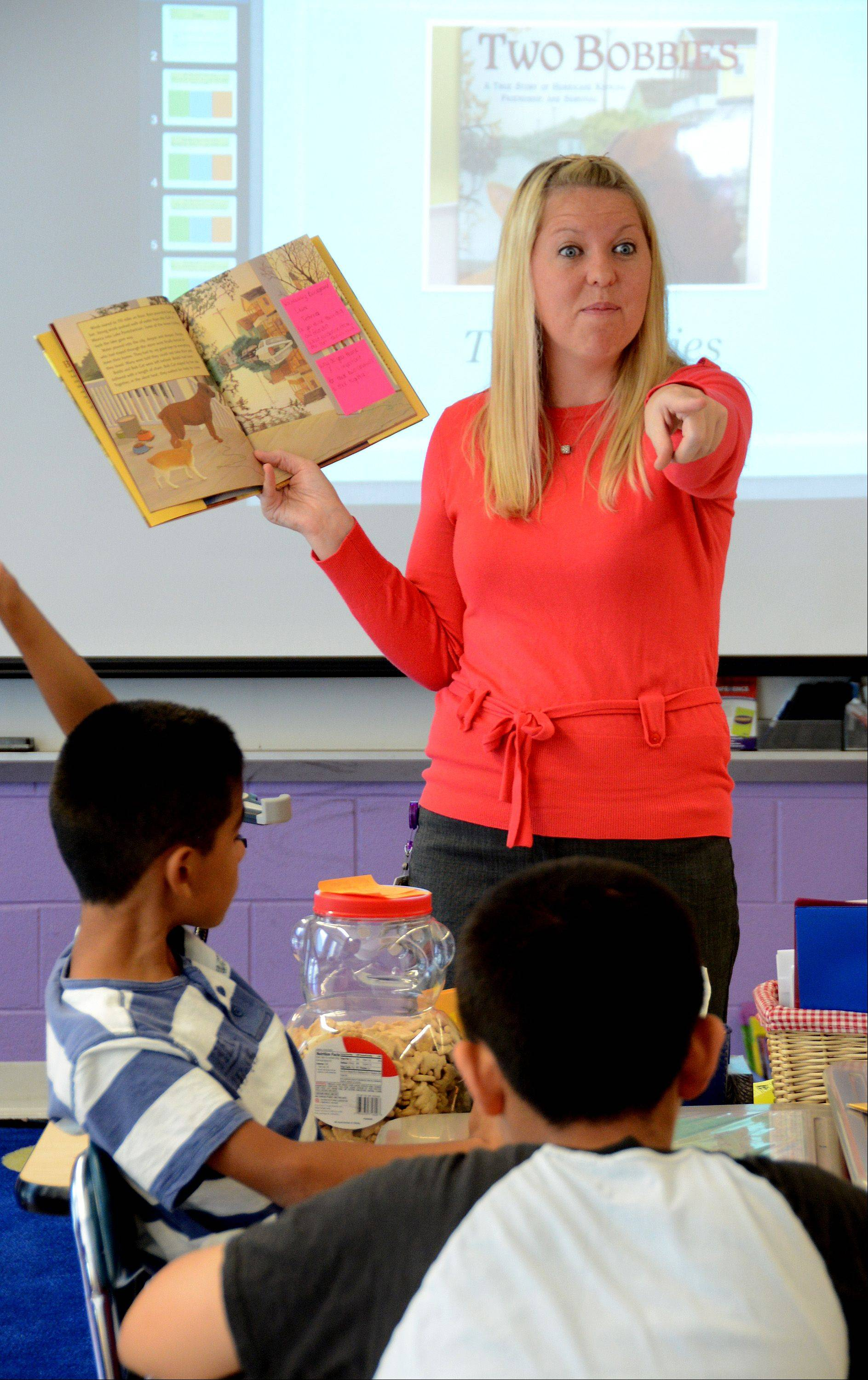 Amy Walsh, a fourth-grade teacher at Tioga Elementary School in Bensenville, works with students on a reading lesson.