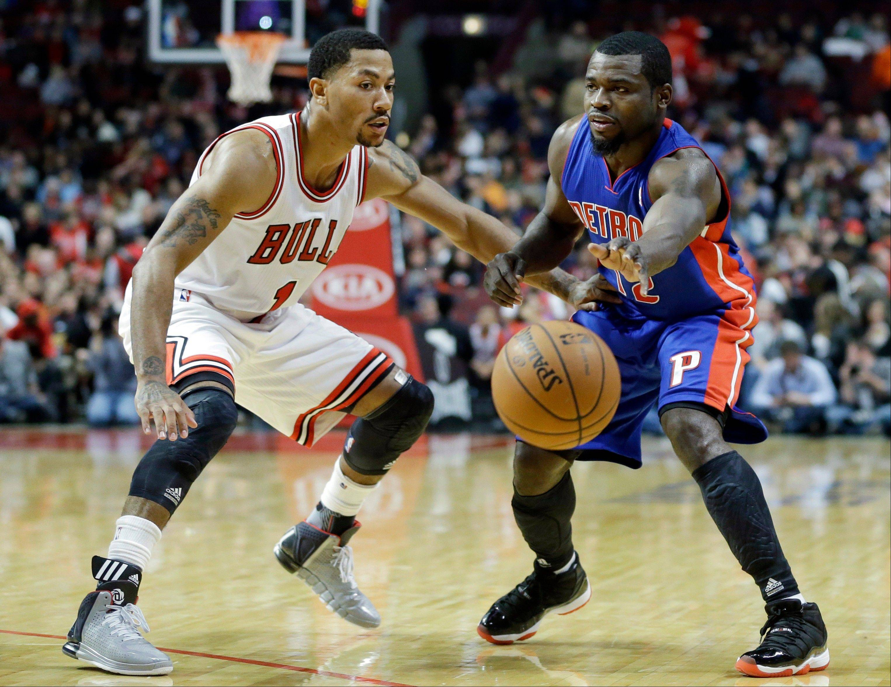 Derrick Rose guards the Pistons' Will Bynum on Wednesday night at the United Center.