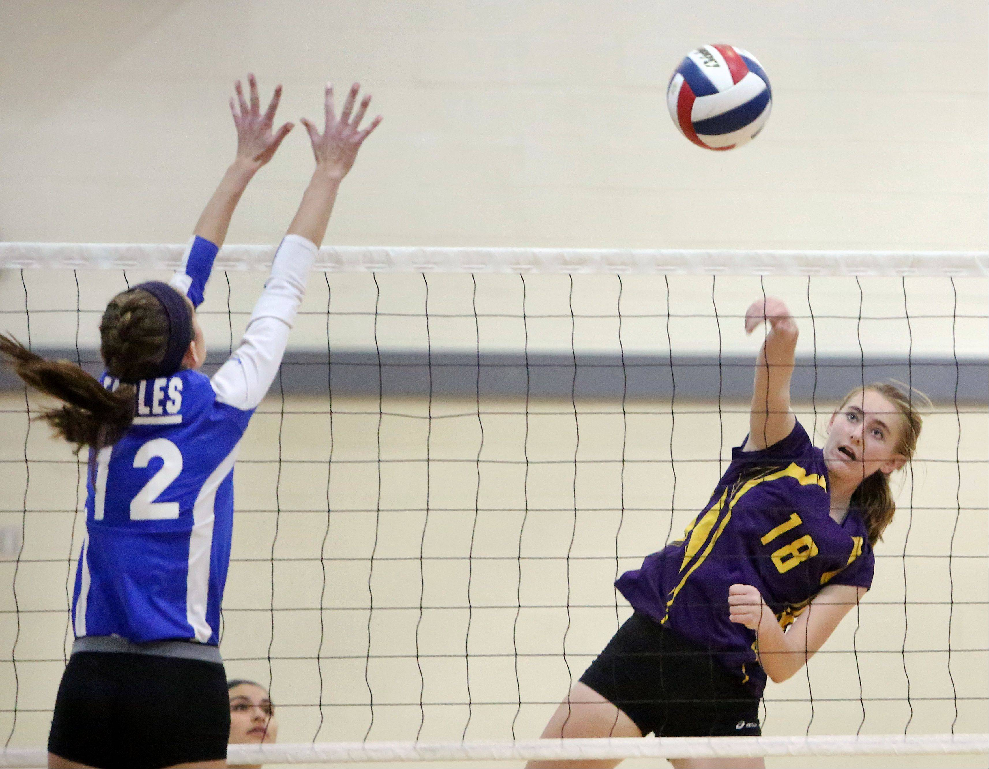 Wauconda's Leanne Sakowicz, right, spikes one at Haley Halberg of Lakes on Wednesday night at Lakes.