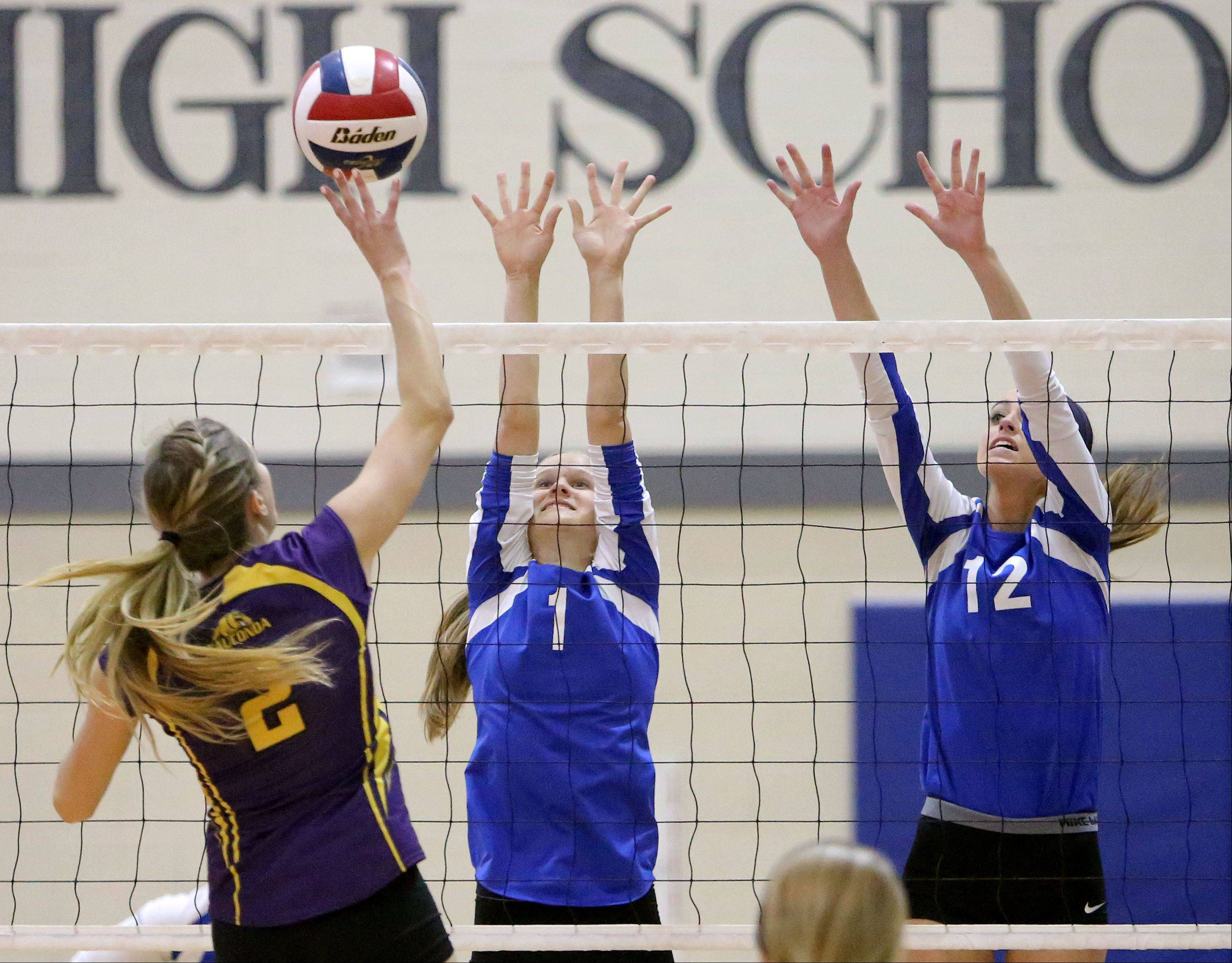 Wauconda's Susan Karhoff directs an attack at Lakes' Abbey Buehler, left, and Haley Halberg on Wednesday night at Lakes.