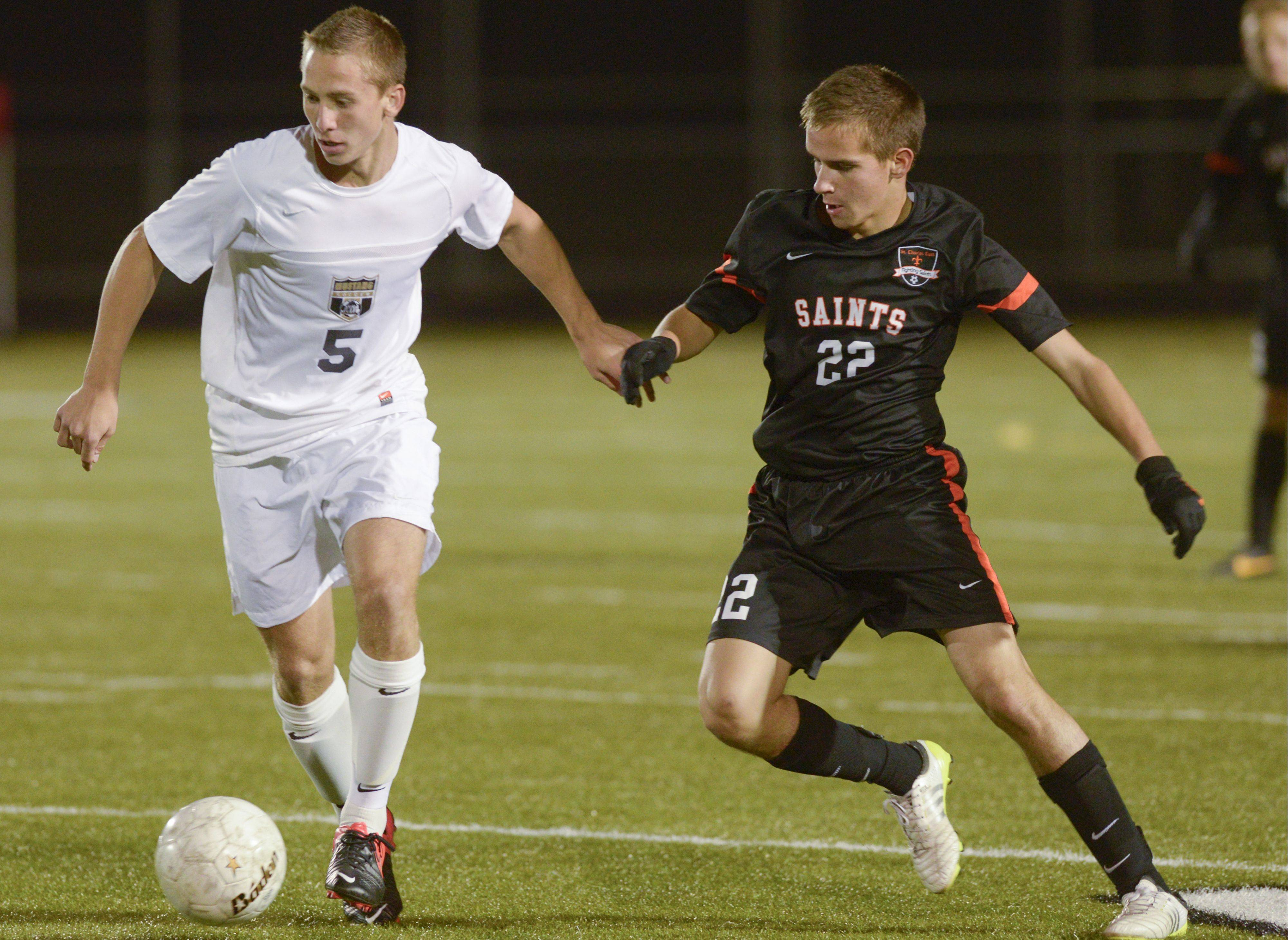 Jake Celinski of Metea Valley and Rob Wolak of St. Charles East work for control of the ball during boys soccer at home Wednesday.