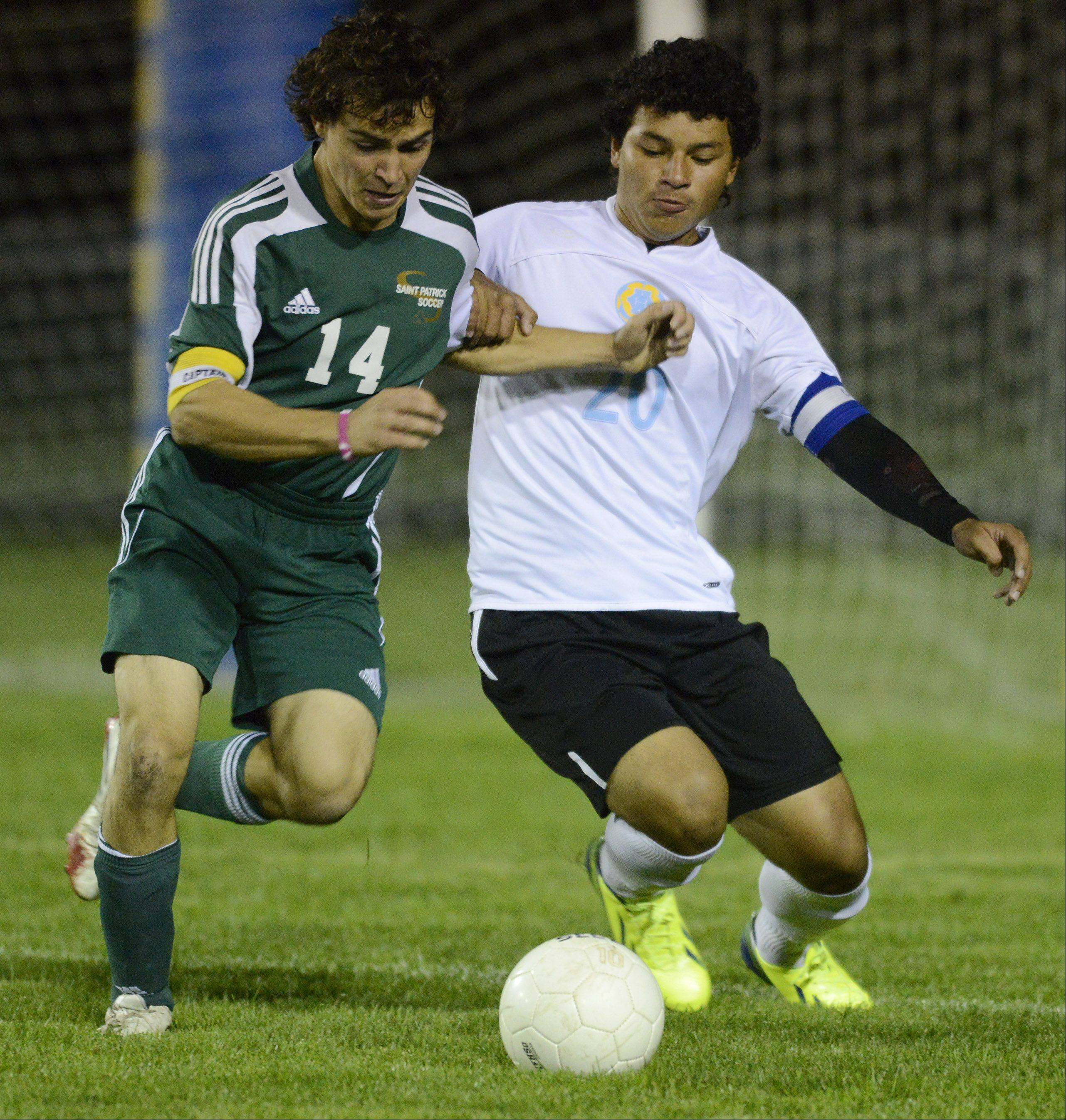 St. Patrick's Paul Samatas, left, and Maine West's Nelson Herrera make contact while pursuing the ball during Wednesday's game in Des Plaines.