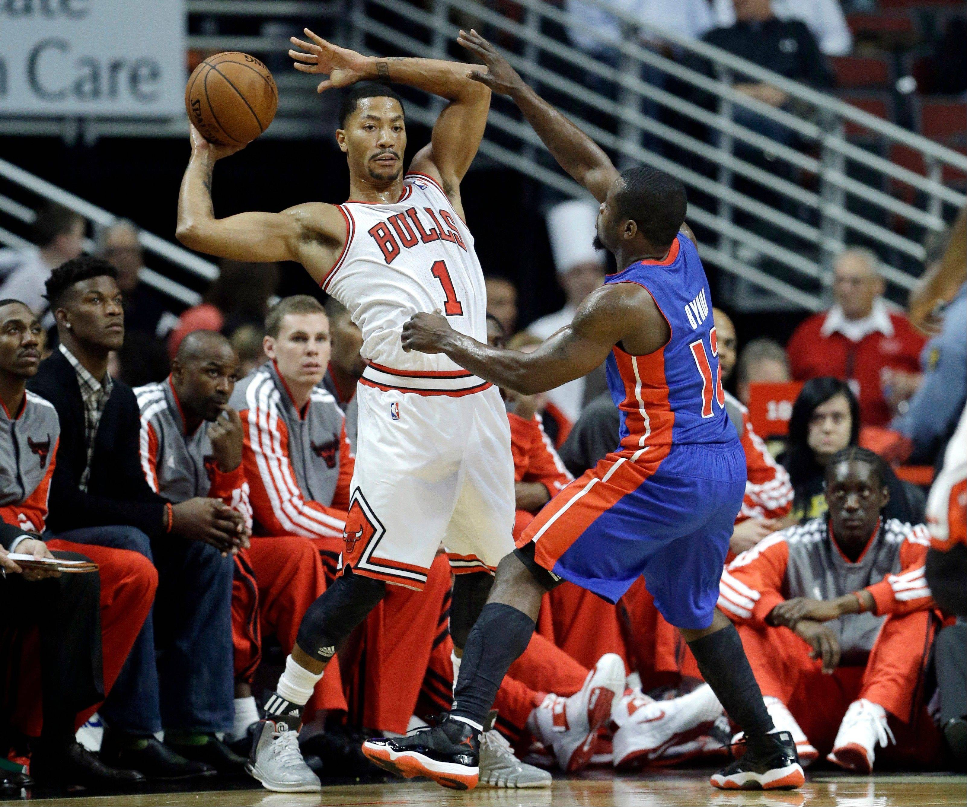 Bulls guard Derrick Rose looks to pass as Pistons guard Will Bynum defends during the first half of Wednesday's preseason game in Chicago.