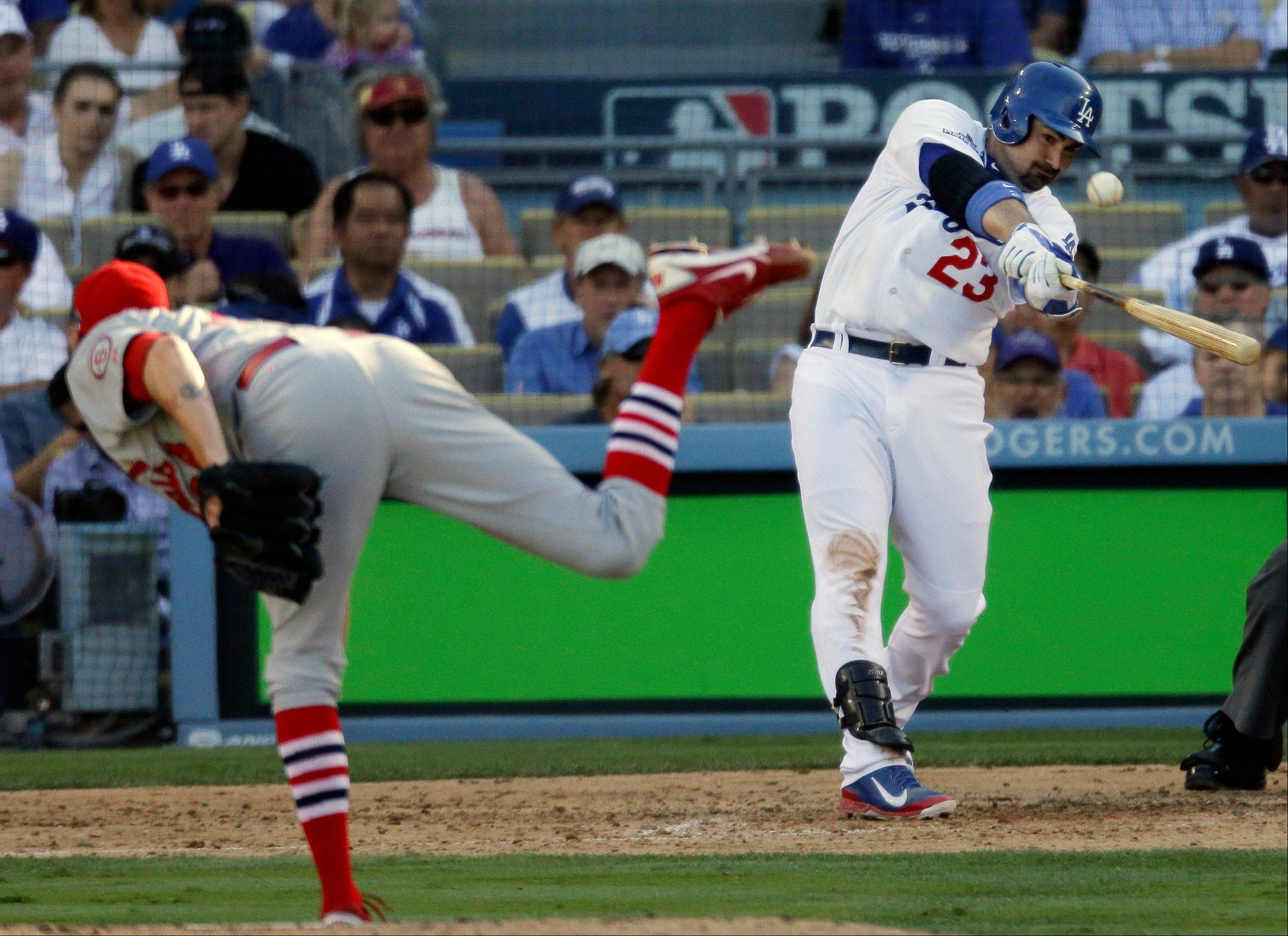 The Dodgers' Adrian Gonzalez hits a home run off St. Louis Cardinals relief pitcher John Axford during the eighth inning.