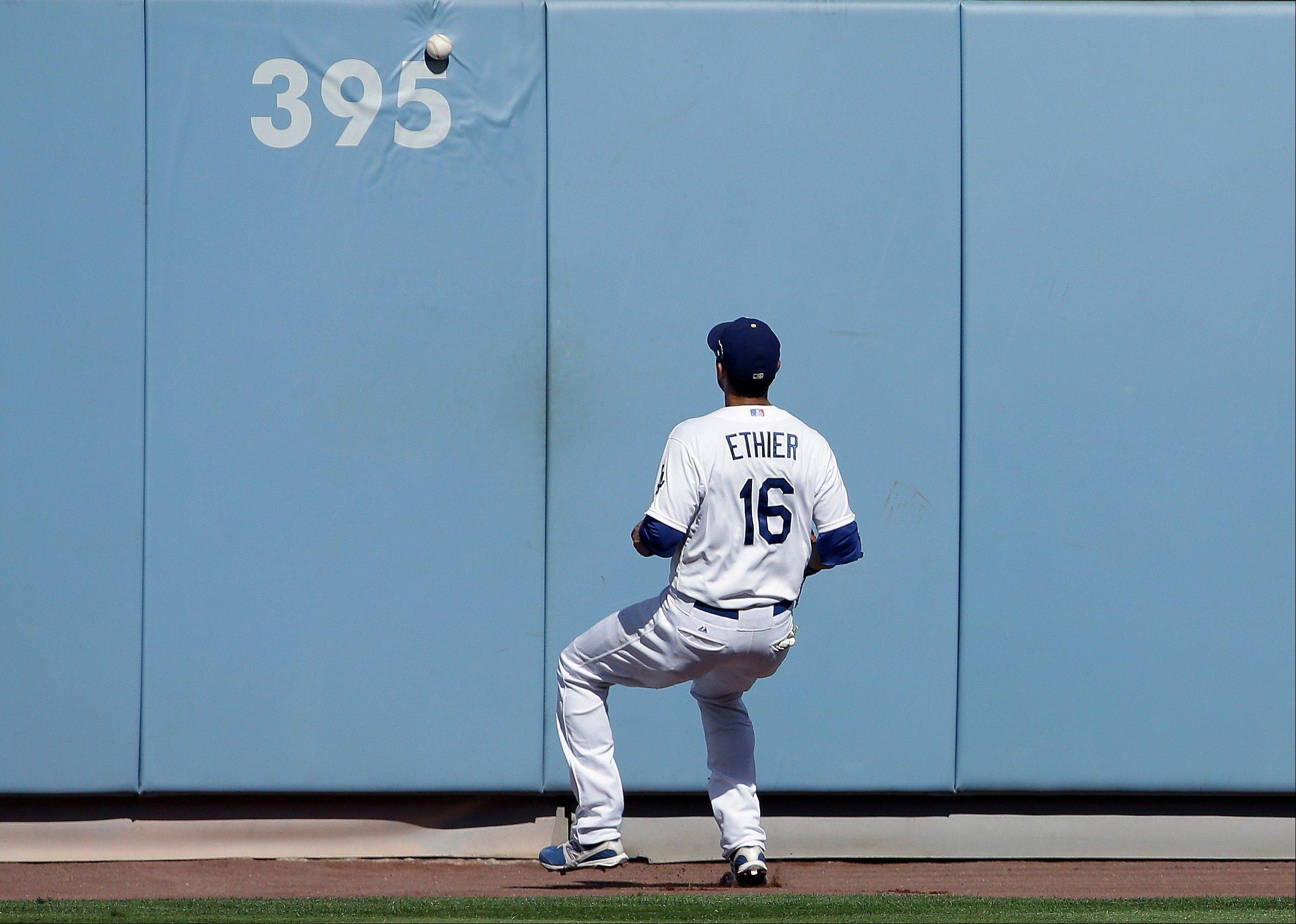 The Dodgers' Andre Ethier watches a triple off the wall by the Cardinals' Carlos Beltran during the third inning.
