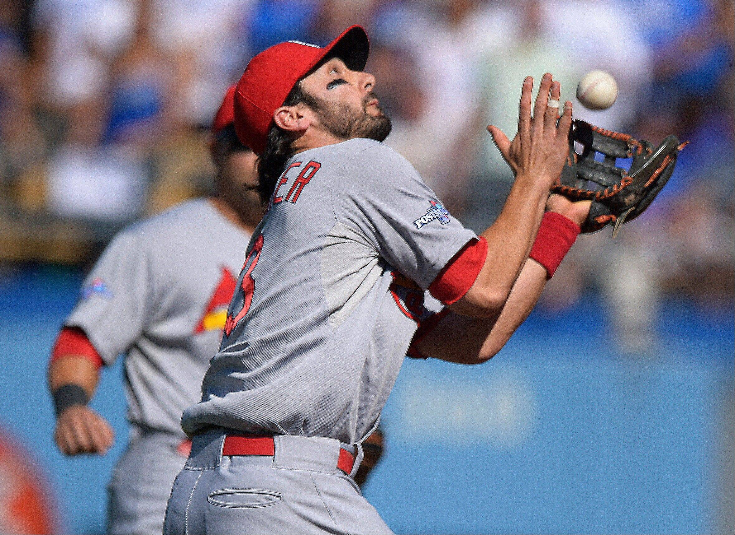 The Cardinals' Matt Carpenter catches a ball hit by the Dodgers' Nick Punto during the second inning of Game 5.