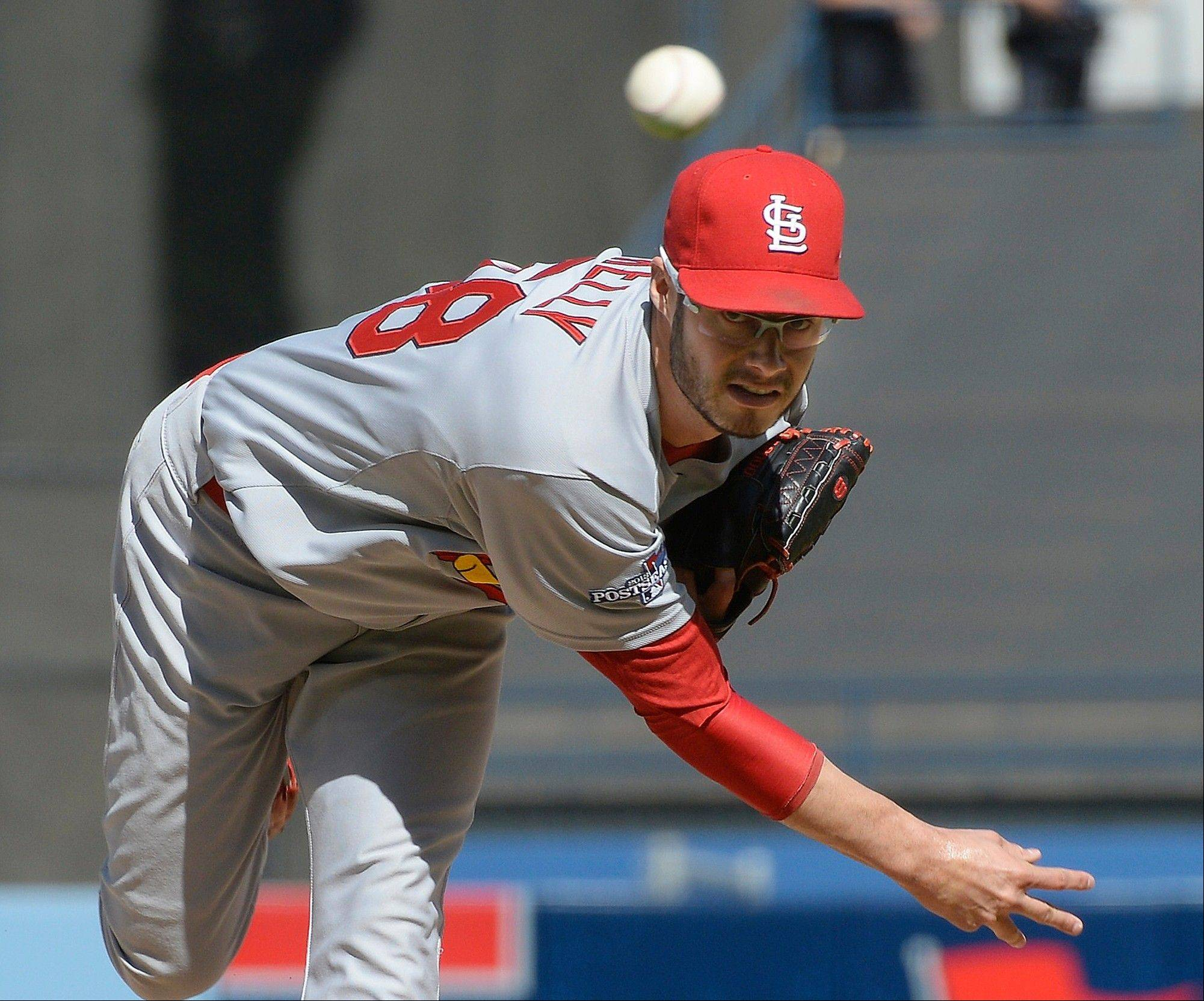 Cardinals starting pitcher Joe Kelly throws during the first inning of Game 5. Kelly took the loss.