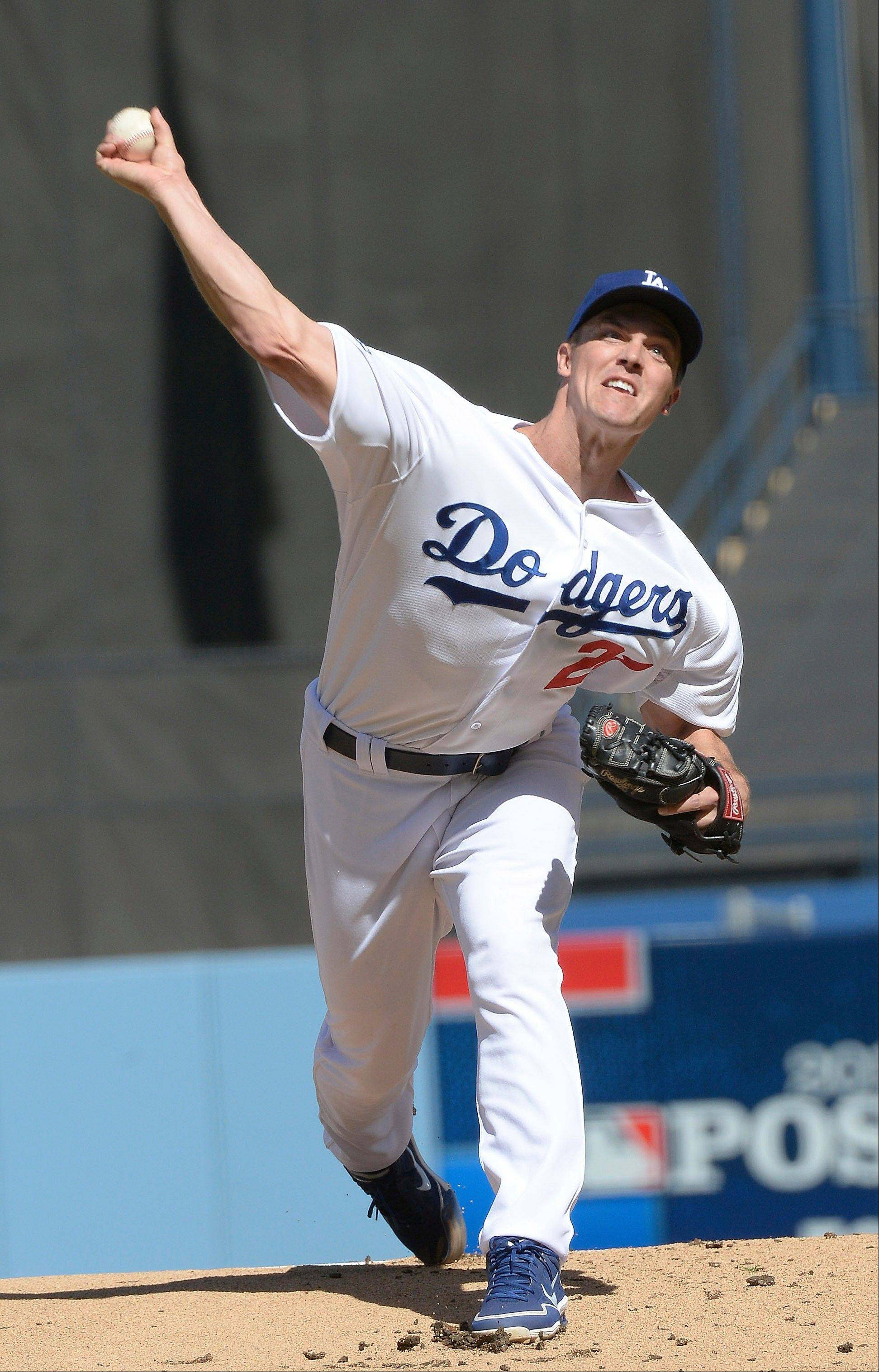 Dodgers starting pitcher Zack Greinke throws during the first inning of Game 5. Greinke struck out four and earned the win.