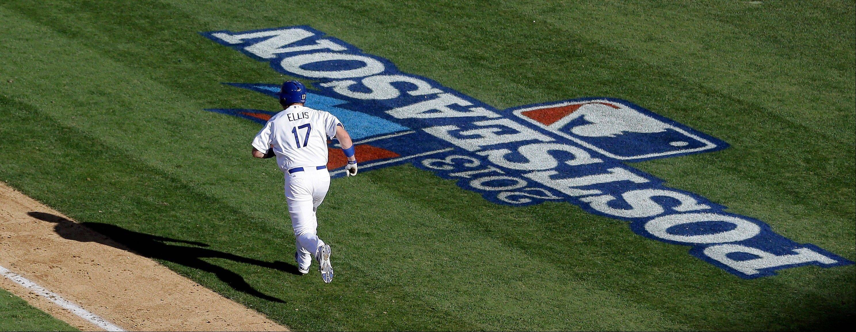 The Dodgers' A.J. Ellis runs after hitting a home run during the seventh inning of Game 5.