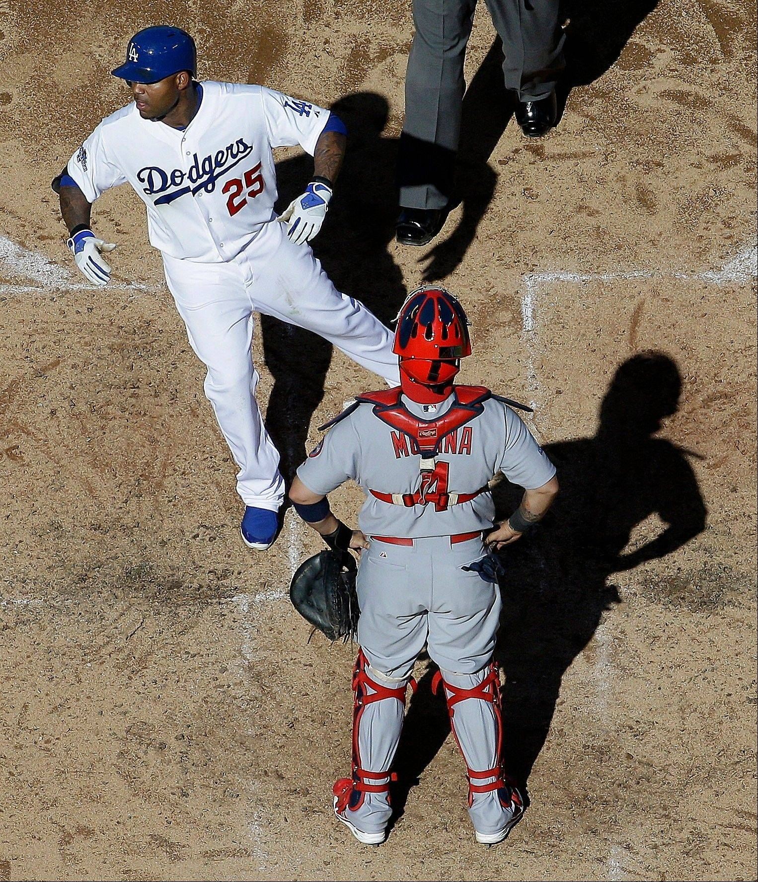 Cardinals catcher Yadier Molina watches as the Dodgers' Carl Crawford crosses home after hitting a home run during the fifth inning.