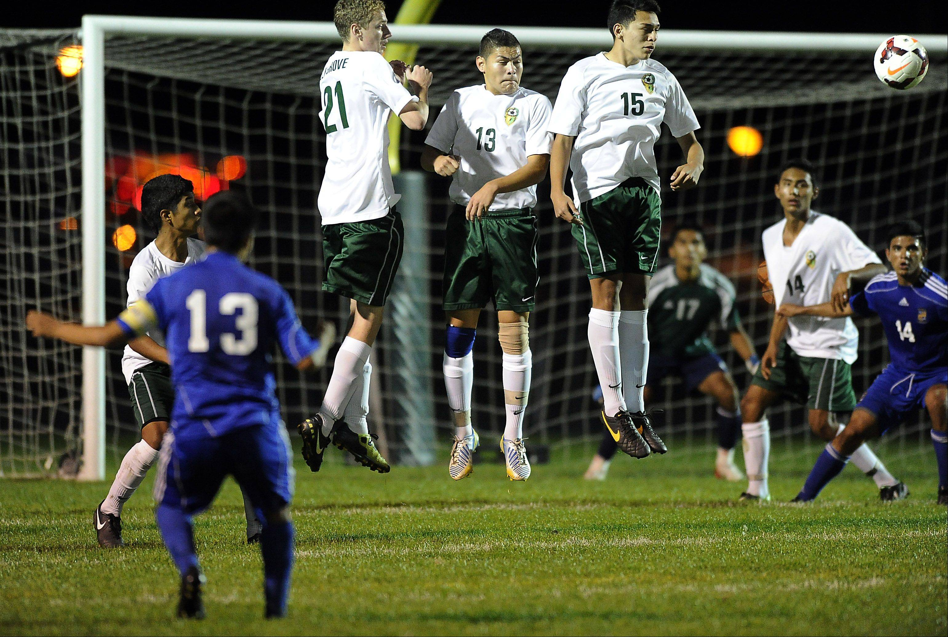 Wheeling's Jose Garcia watches his direct kick sail past Elk Grove's defensive wall for a goal in MSL East action.