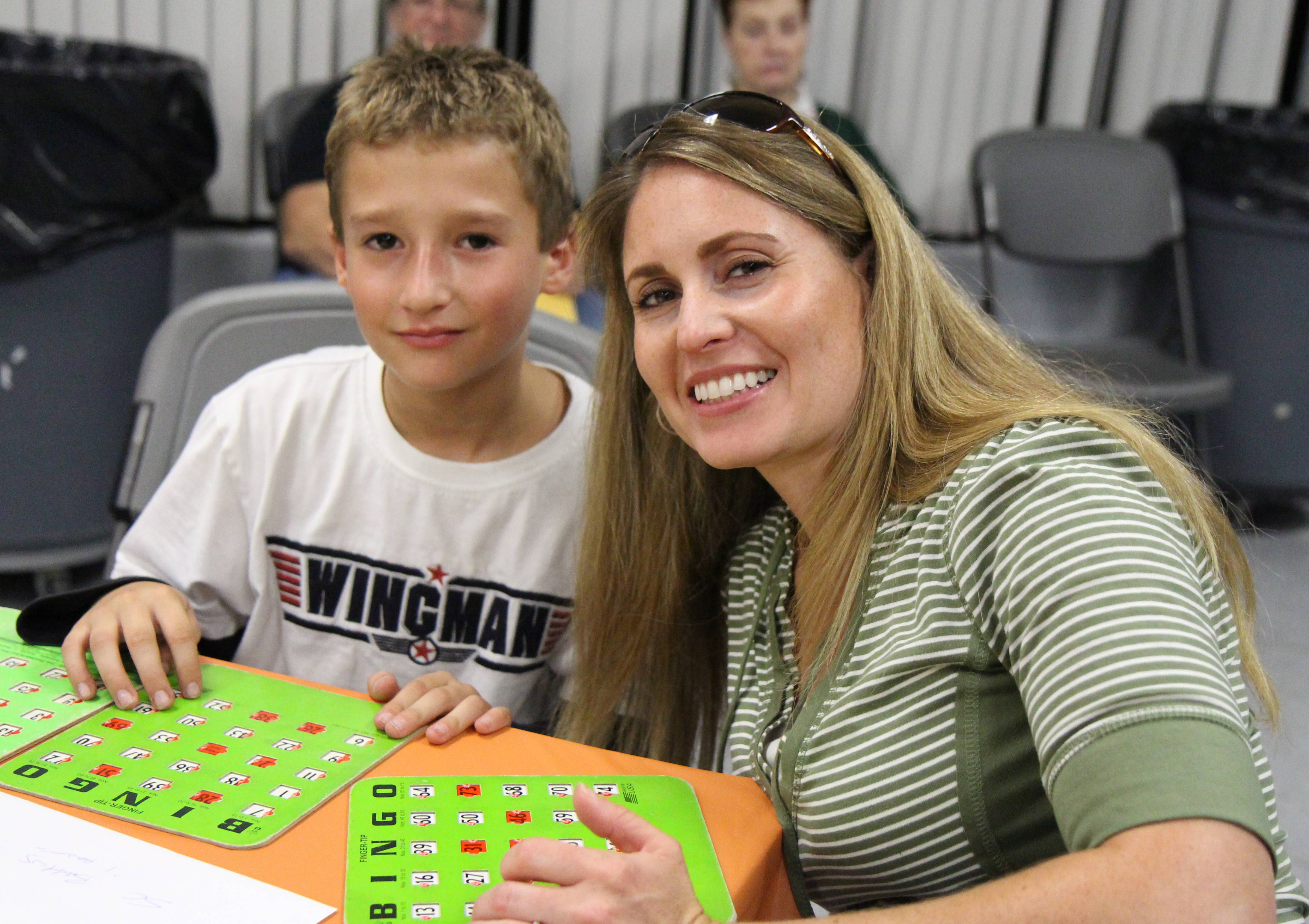 Debra Lloyd and son Caden, 10, play bingo at the Community Recreation Center.