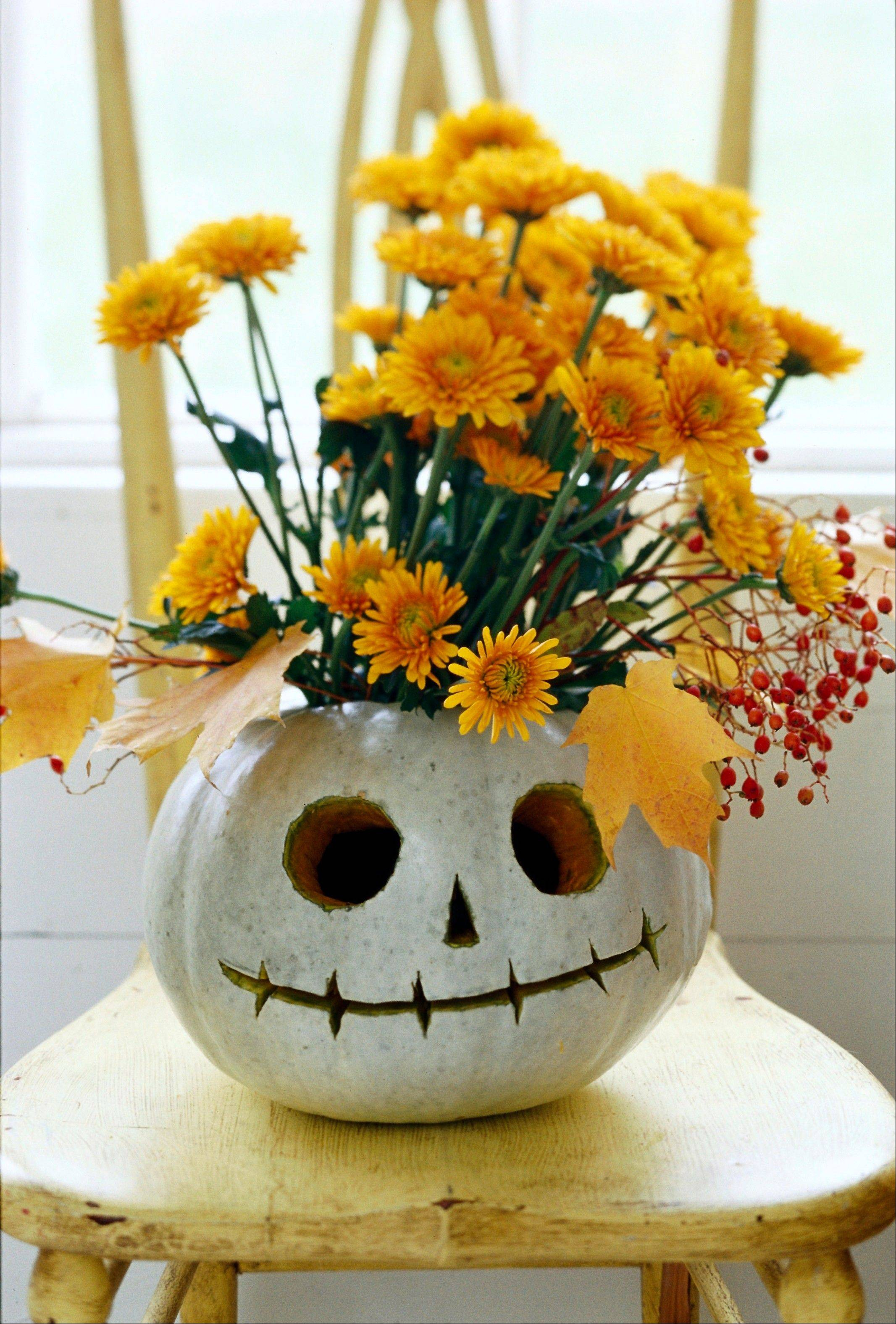A pumpkin can be made into a vase. This one is carved into a likeness of the animated character Jack Skellington from �The Nightmare Before Christmas.�