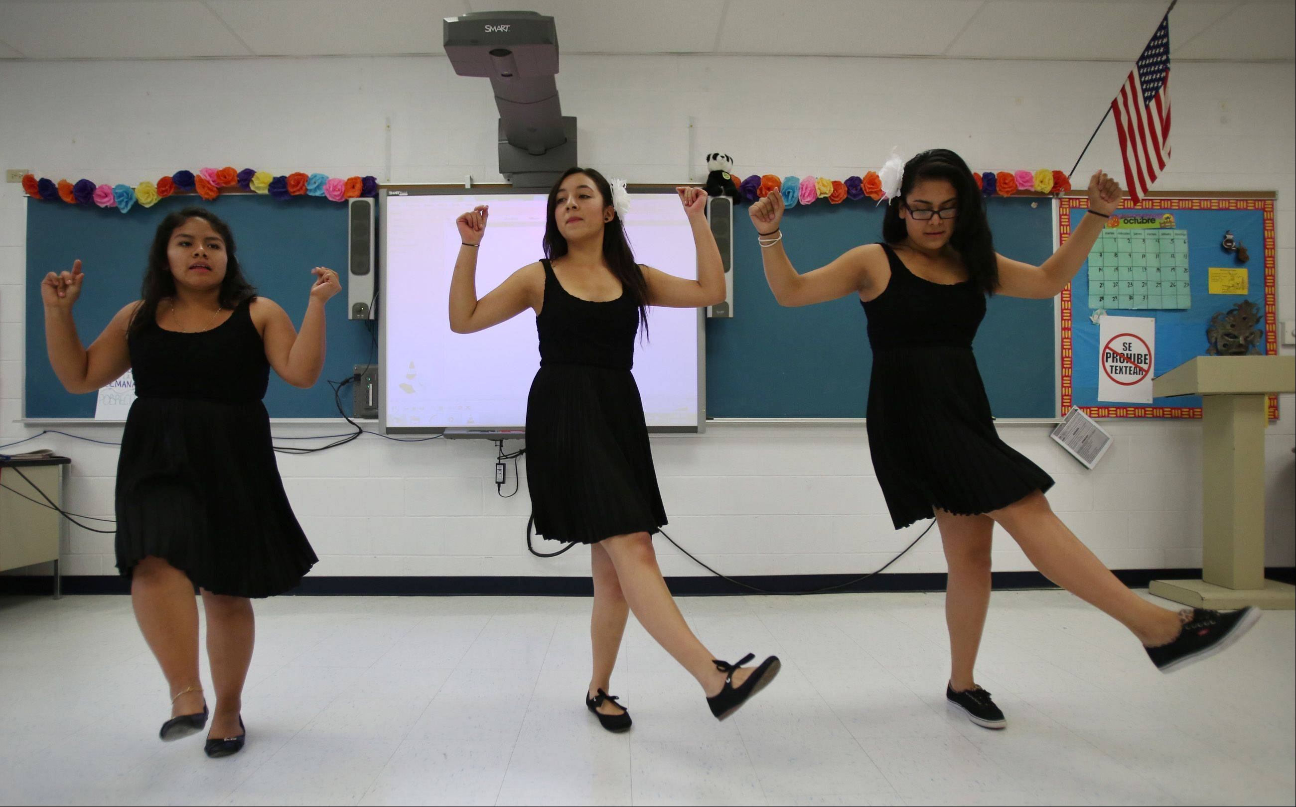 Dundee-Crown students Berenice Vidigaray, left, Veronica Carrillo and Mitzy Duran rehearse an Argentine dance number Thursday in preparation for the D300 Multicultural Festival Sunday at Spring Hill Mall in West Dundee. The students are among more than 20 groups that will perform at the inaugural festival, which features talent from within the district and community.