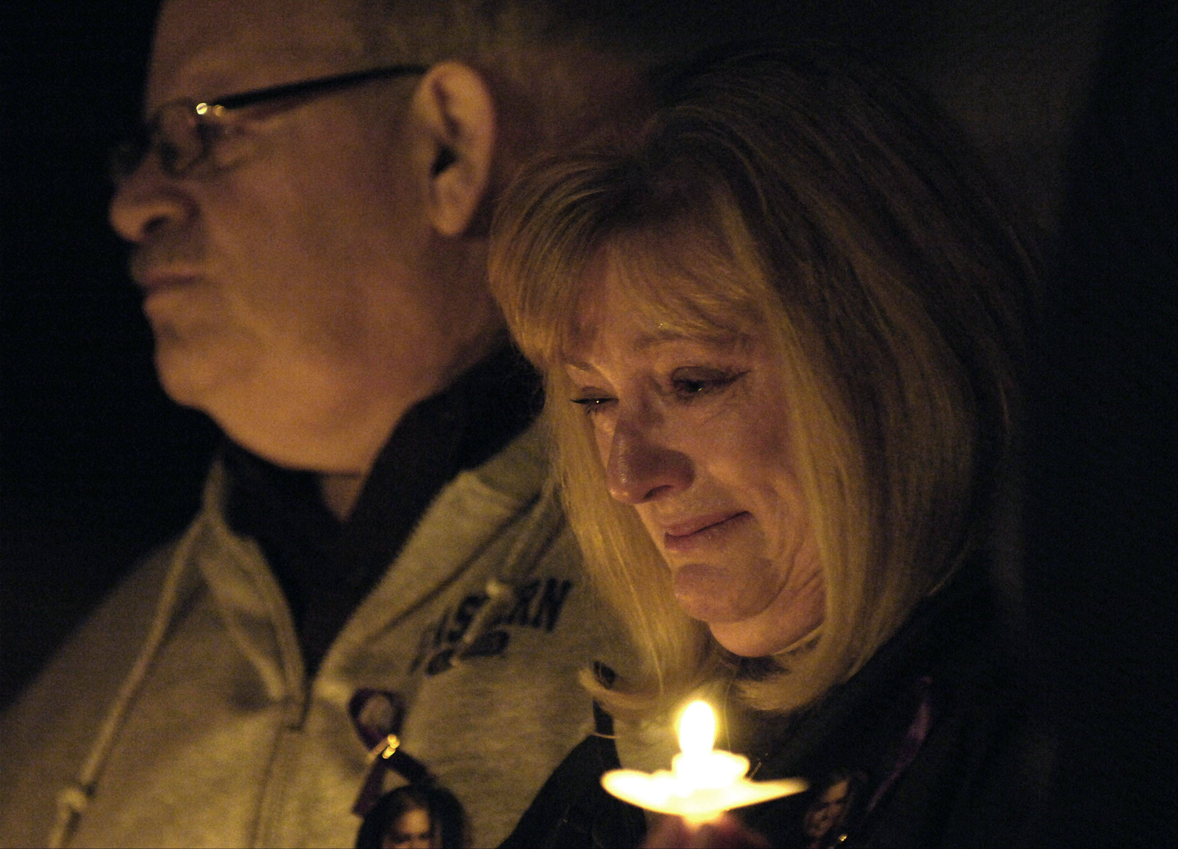 Patricia Rosenberg, with husband Michael, fights back tears while a song is played for her late daughter, Andrea Will, during candlelight vigil in 2010 at the Peg Bond Center in Batavia. Will was murdered by her ex-boyfriend in 1998 while a student at Eastern Illinois University.