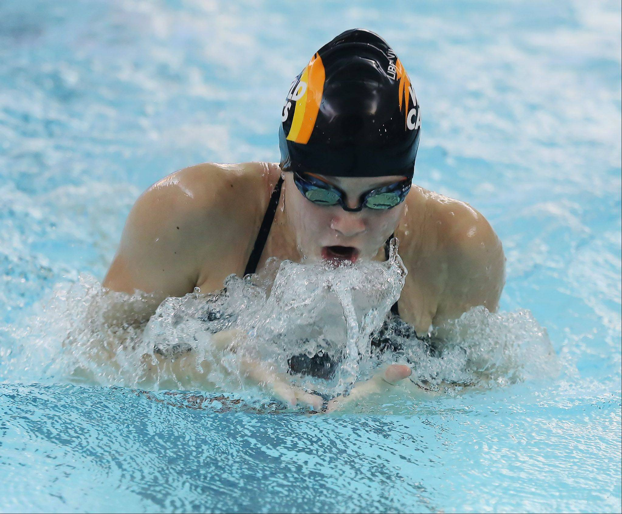 Libertyville�s Macey Neubauer swims the breaststroke during the 200-yard medley relay during Thursday�s meet against at Libertyville.