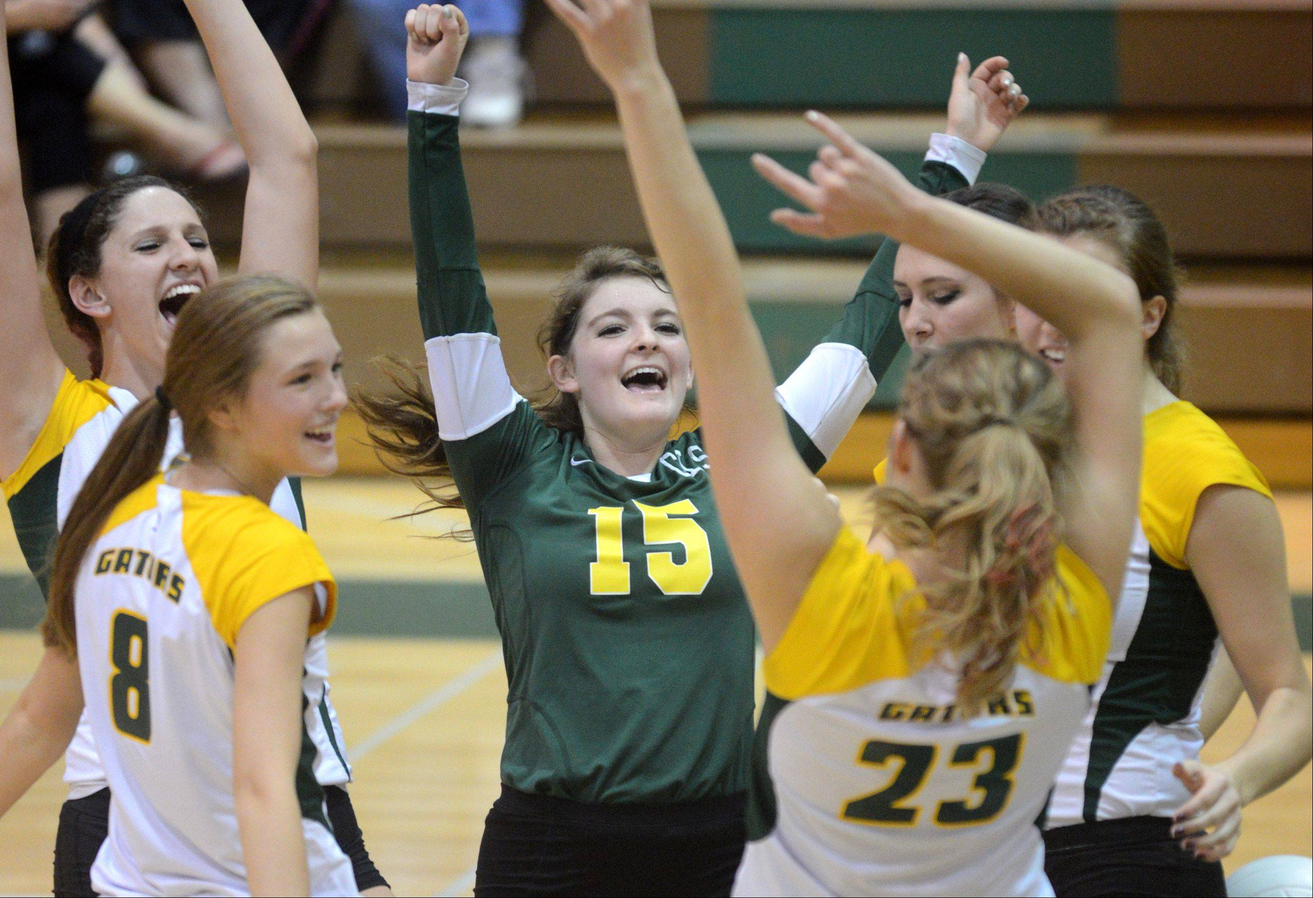 Crystal Lake South�s Hannah Wilson, center, gets revved up with her teammates during a victory over Huntley at Crystal Lake on Thursday night.