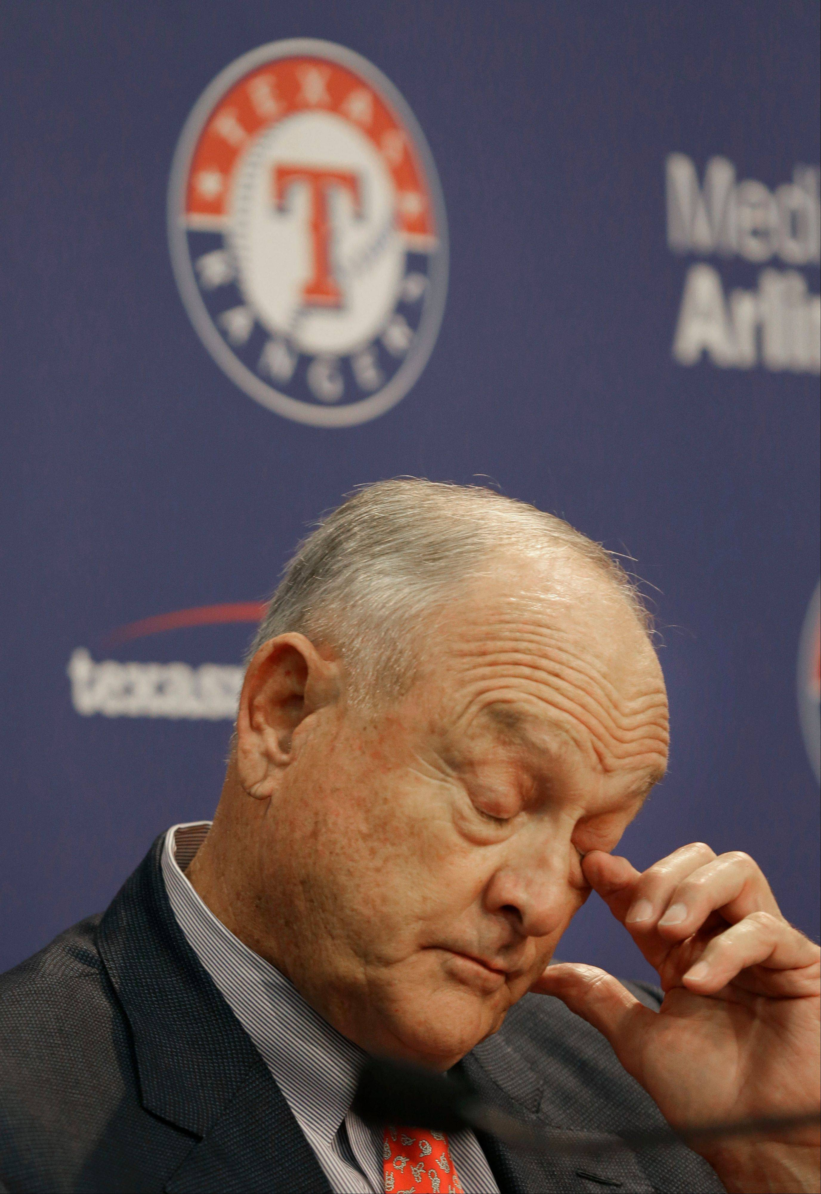 Texas Rangers CEO and President Nolan Ryan wipes his eye during a news conference announcing his retirement from the ballclub Thursday, Oct. 17, 2013 in Arlington, Texas. Ryan will step down at the end of this month. (AP Photo/LM Otero)