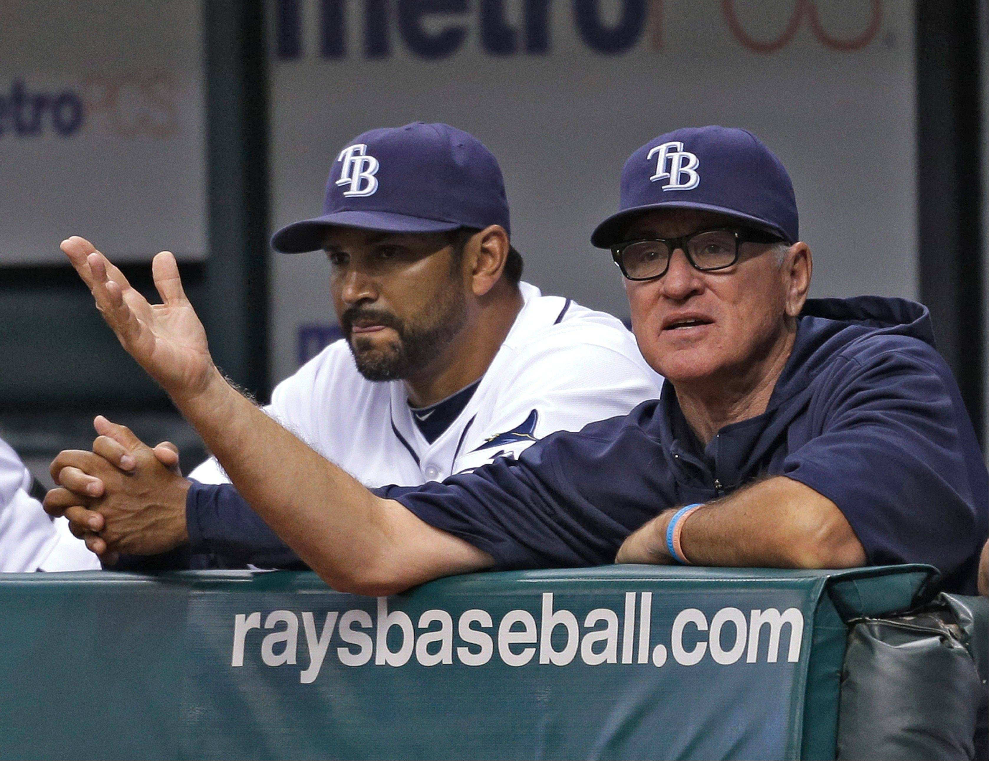 Tampa Bay bench coach Dave Martinez, shown here with manager Joe Maddon, right, has interviewed for the Cubs managerial opening. He played for the Cubs and the White Sox.