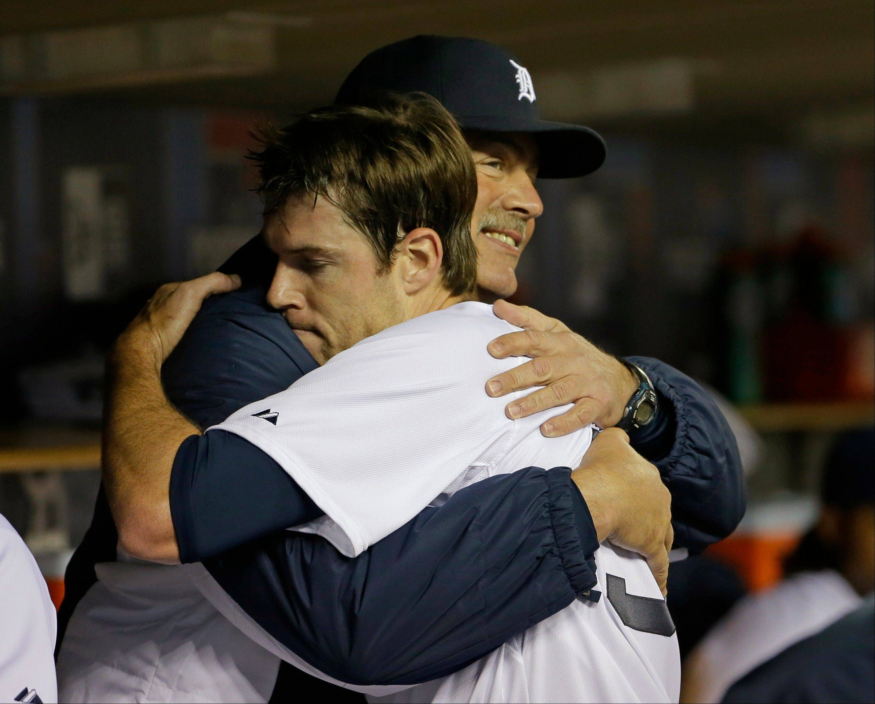 Detroit starting pitcher Doug Fister hugs pitching coach Jeff Jones after the sixth inning during Game 4 of the American League Championship Series against the Boston Red Sox. The Tigers won 7-3 Wednesday night at home.