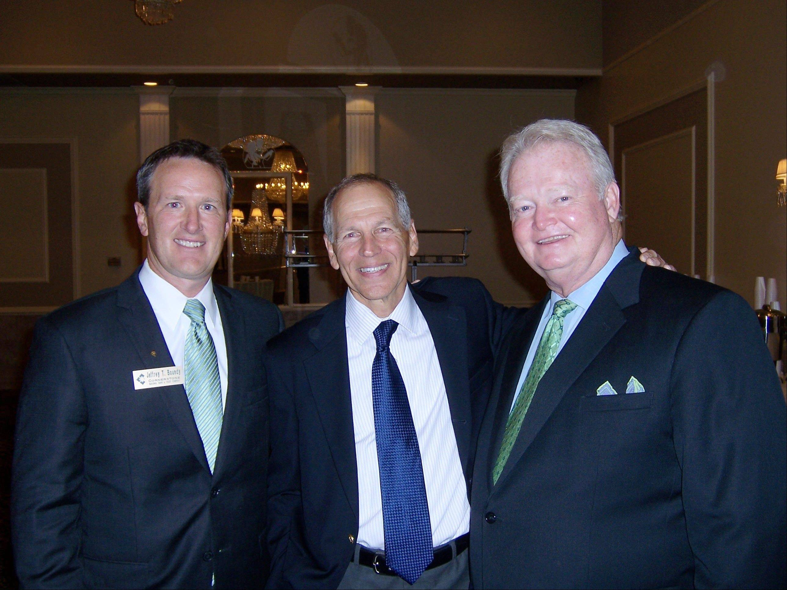 Jeff Boundy, left, president and senior lender at Cornerstone National Bank & Trust Company, economist Robert Genetski and Tom MacCarthy, chairman and CEO at Cornerstone, were part of Thursday's 10th annual economic forecast held in Palatine.