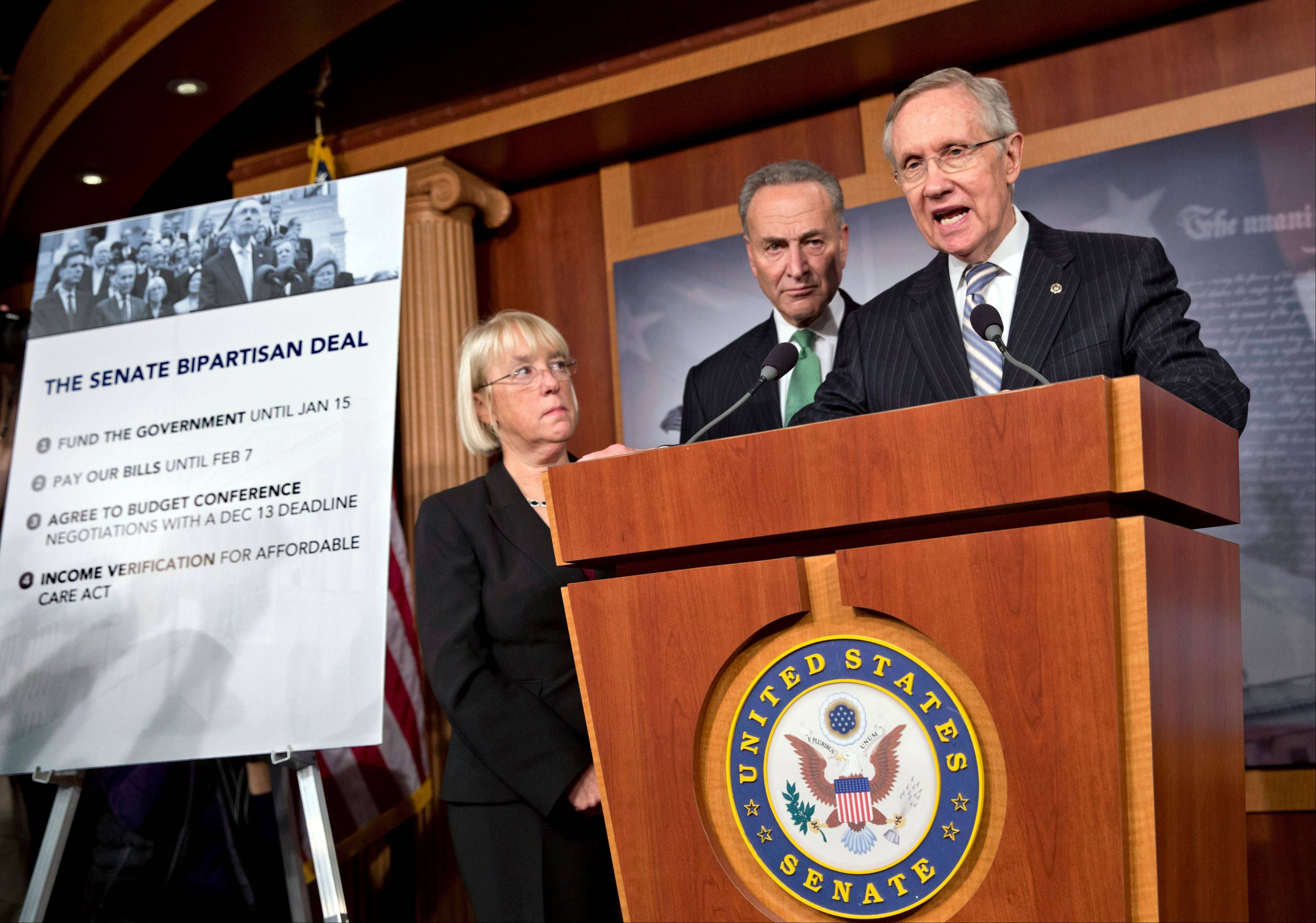 Senate Majority Leader Harry Reid, D-Nev., speaks with reporters after voting on a measure to avert a threatened Treasury default and reopen the government after a partial, 16-day shutdown, at the Capitol in Washington, Wednesday, Oct. 16, 2013, as Sen. Patty Murray, D-Wash., chair of the Senate Budget Committee, Sen. Chuck Schumer, D-N.Y., listen.