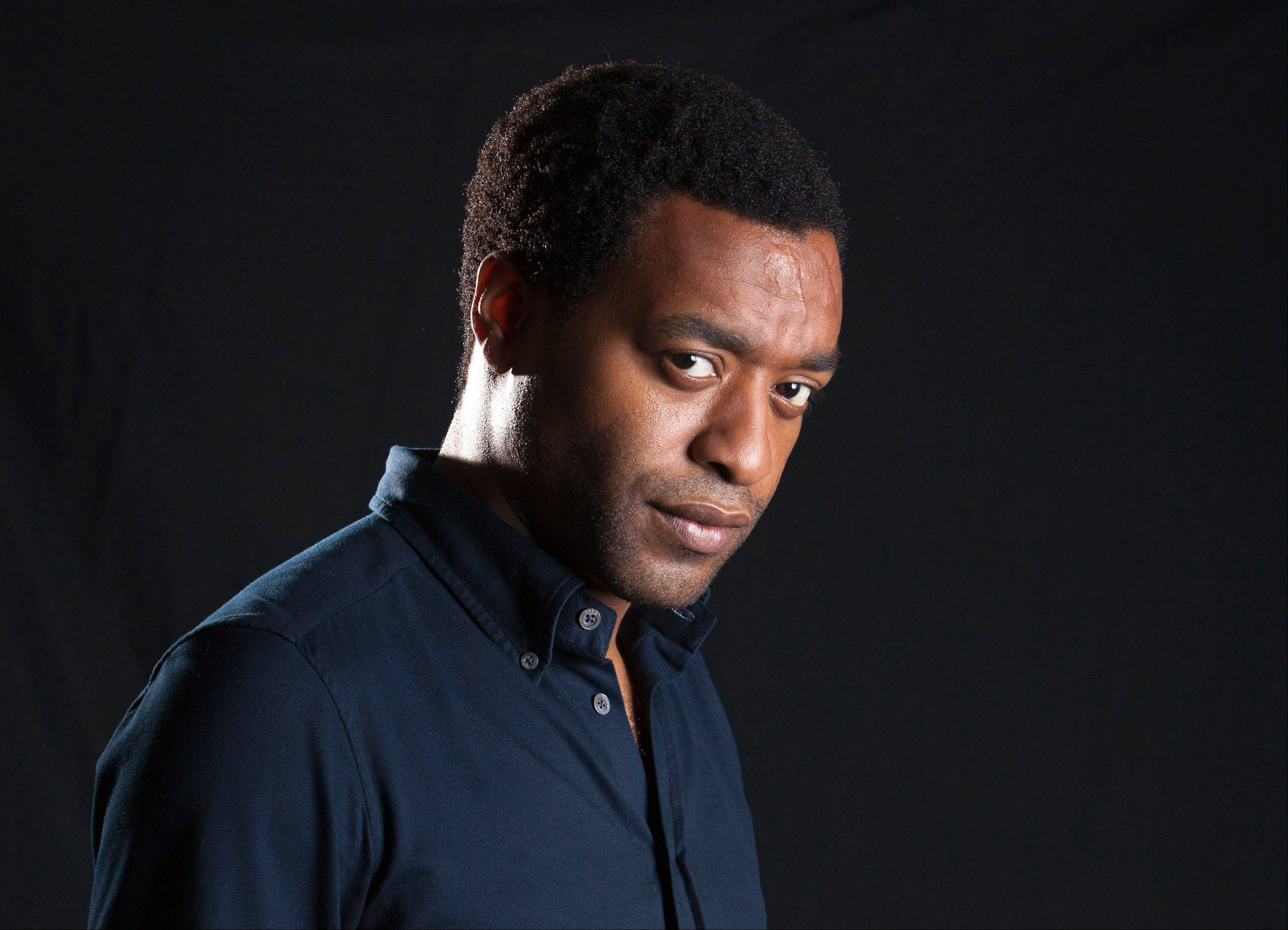 "British actor Chiwetel Ejiofor plays Solomon Northup, a free black man who was abducted and sold into slavery, in ""12 Years A Slave."""