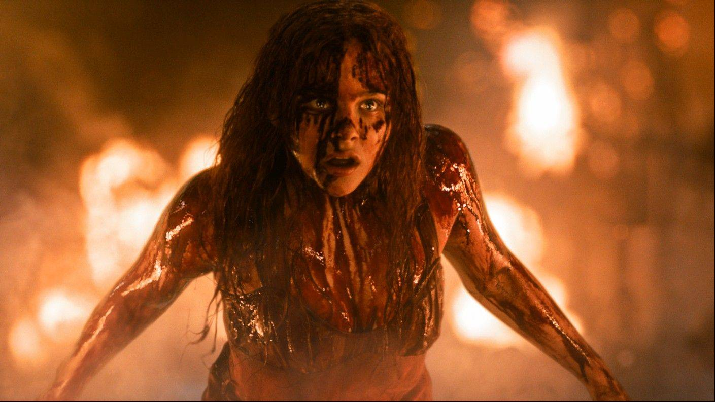 "A bullied teenager (Chloe Grace Moretz) with telekinetic powers snaps at the prom in Kimberly Peirce's remake of ""Carrie."""